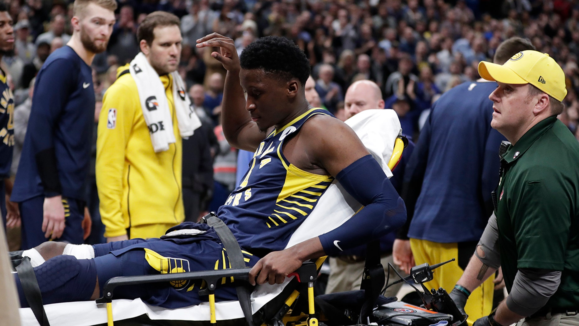 Indiana Pacers guard Victor Oladipo is taken off the court on a stretcher after he was injured during the first half of the team's NBA basketball game against the Toronto Raptors in Indianapolis, Wednesday, Jan. 23, 2019.
