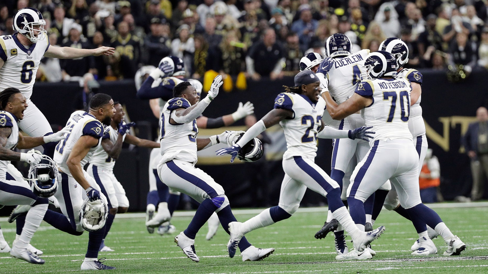 dd63cd47eba Los Angeles Rams players celebrate after overtime of the NFL football NFC  championship game against the