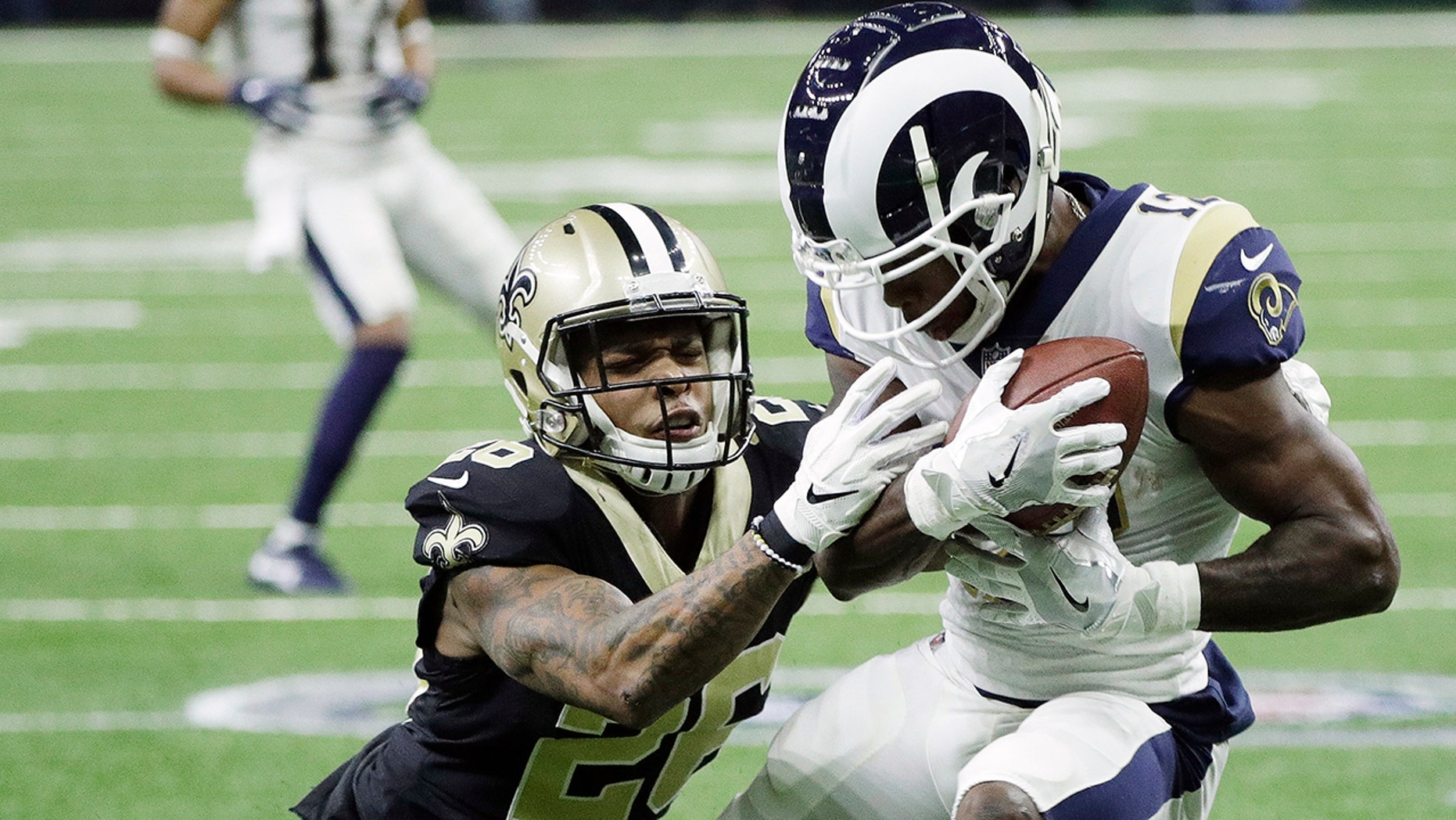 Los Angeles Rams' Brandin Cooks catches a pass in front of New Orleans Saints' P.J. Williams during the first half the NFL football NFC championship game, Sunday, Jan. 20, 2019, in New Orleans.