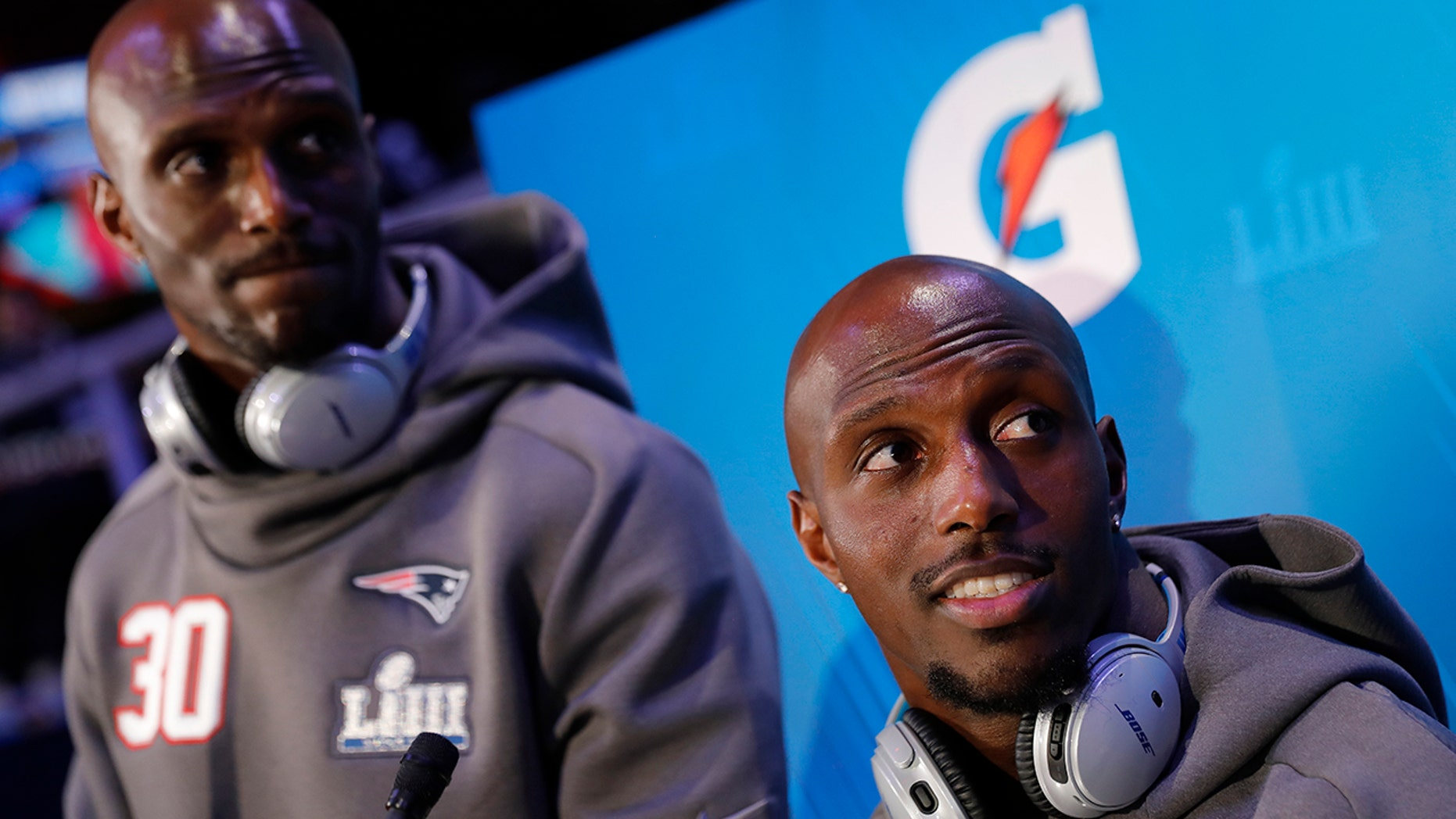 New England Patriots' Jason McCourty and Devin McCourty answer questions during Opening Night for the NFL Super Bowl 53 football game Monday, Jan. 28, 2019, in Atlanta.