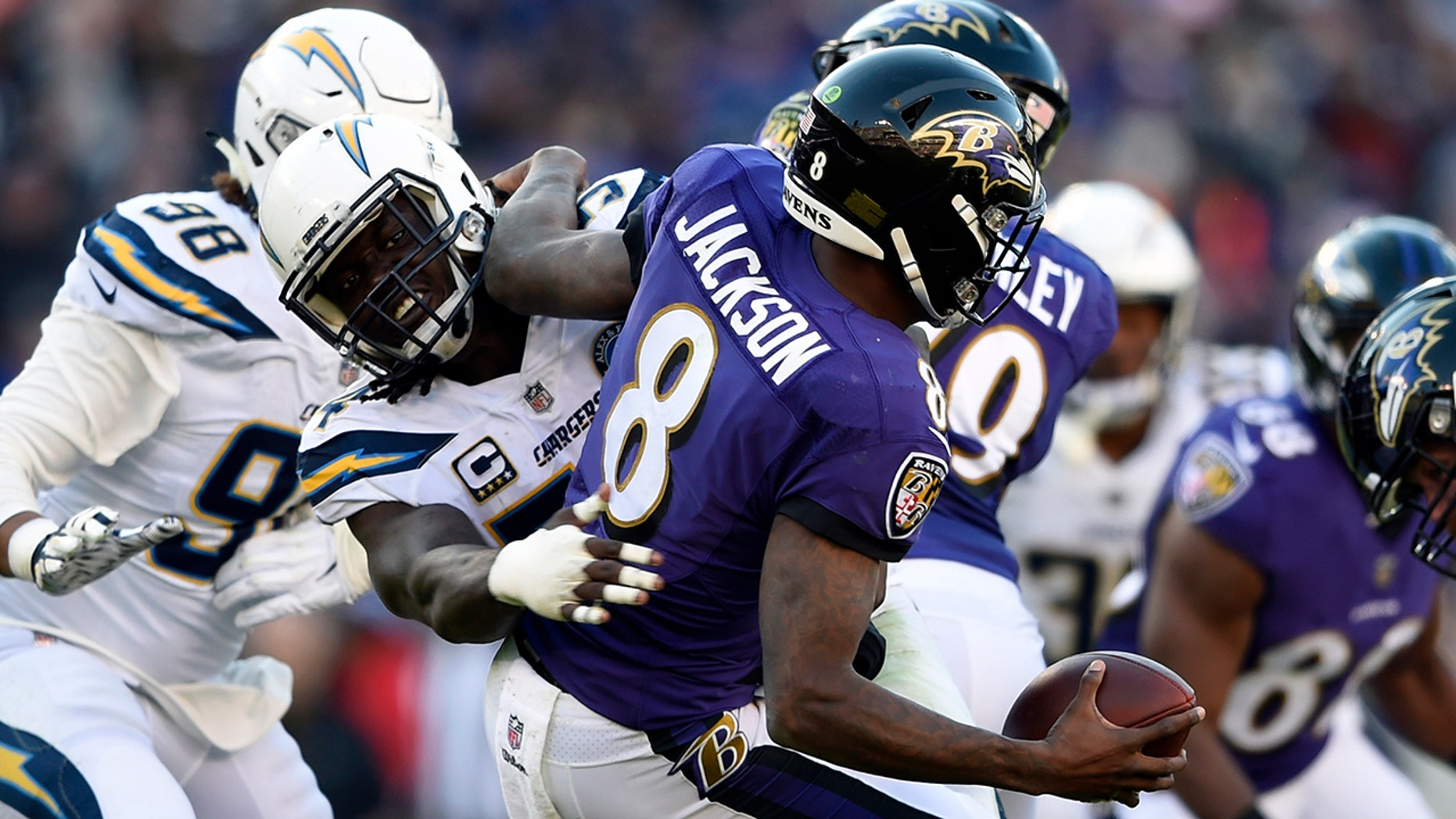 Baltimore Ravens quarterback Lamar Jackson (8) is sacked by Los Angeles Chargers defensive end Melvin Ingram in the second half of an NFL wild card playoff football game, Sunday, Jan. 6, 2019, in Baltimore.