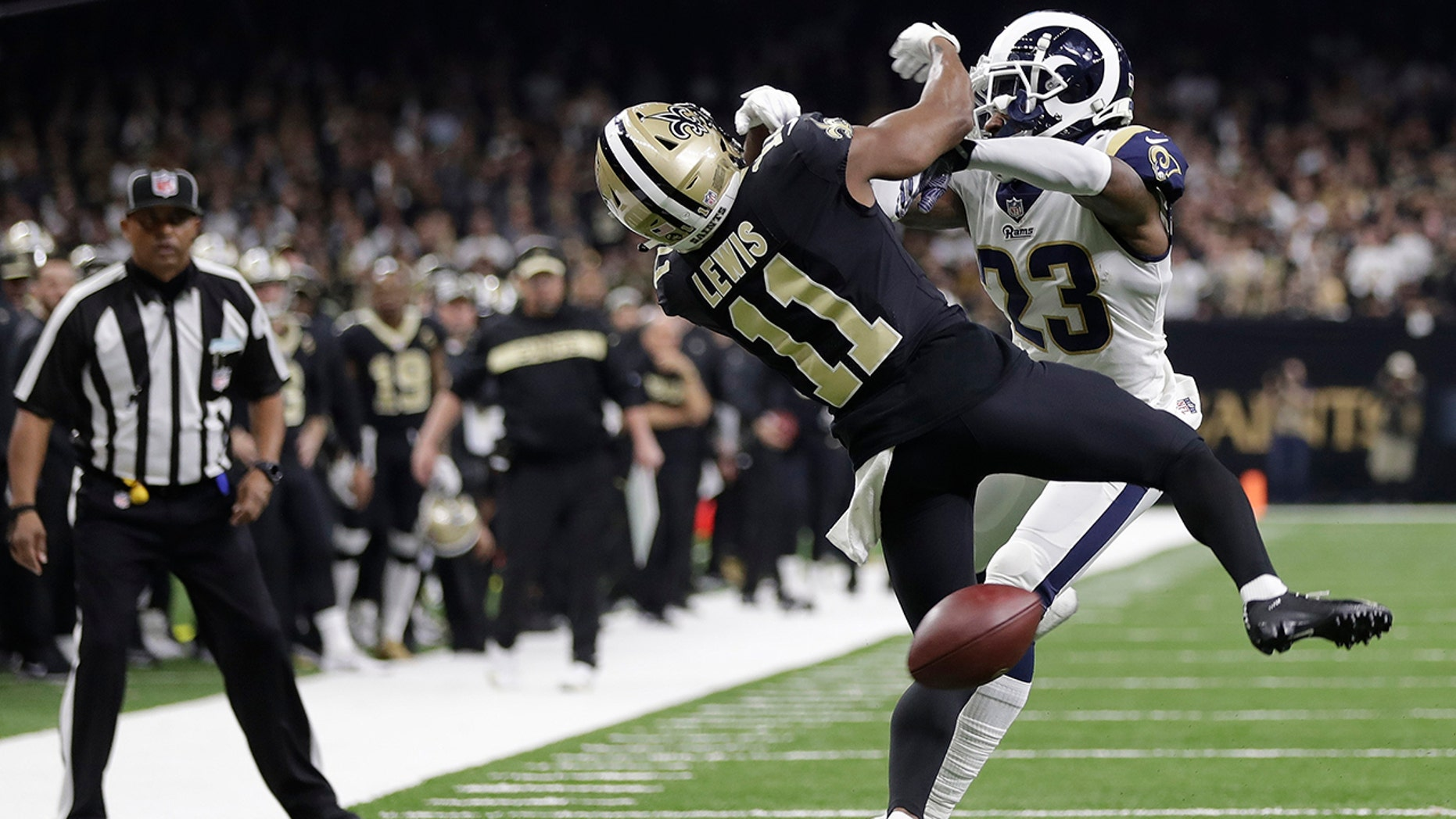 New Orleans Saints wide receiver Tommylee Lewis (11) works for a coach against Los Angeles Rams defensive back Nickell Robey-Coleman (23) during the second half the NFL football NFC championship game Sunday, Jan. 20, 2019, in New Orleans. The Rams won 26-23.