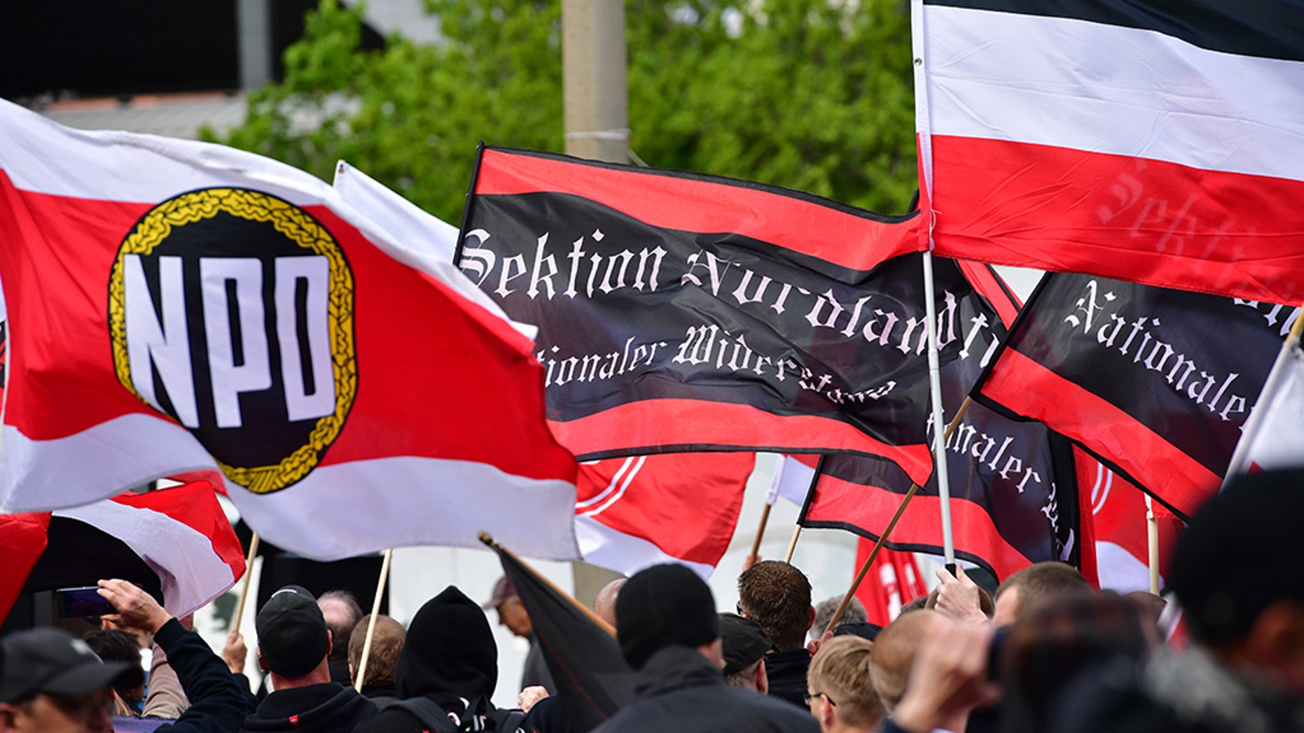 "The flags of ""Sektion Nordland"" and flags of the far-right NPD political party are seen while gathering to march on May Day on May 1, 2018 in Erfurt, Germany."