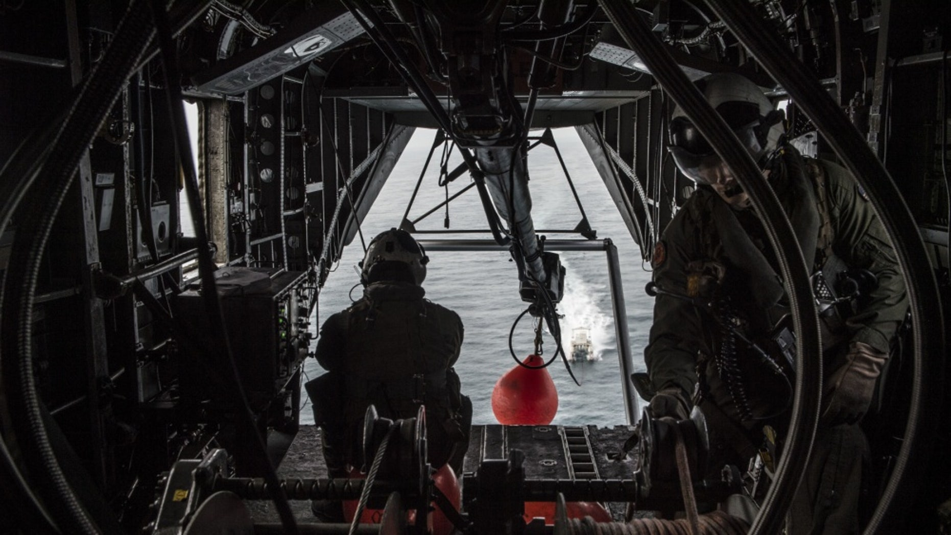 File photo - ARABIAN GULF (May 2, 2015) – Sailors assigned to the Blackhawks of Helicopter Mine Countermeasure Squadron (HM-15) monitor a tow line inside of a MH-53E Sea Dragon pulling an MK-105 Magnetic Influence Minesweeping System during mine countermeasure training operations aboard forward staging base (Interim) USS Ponce (AFSB(I)-15). (U.S. Navy photo by Mass Communication Specialist 1st Class Joshua Bryce Bruns/Released)