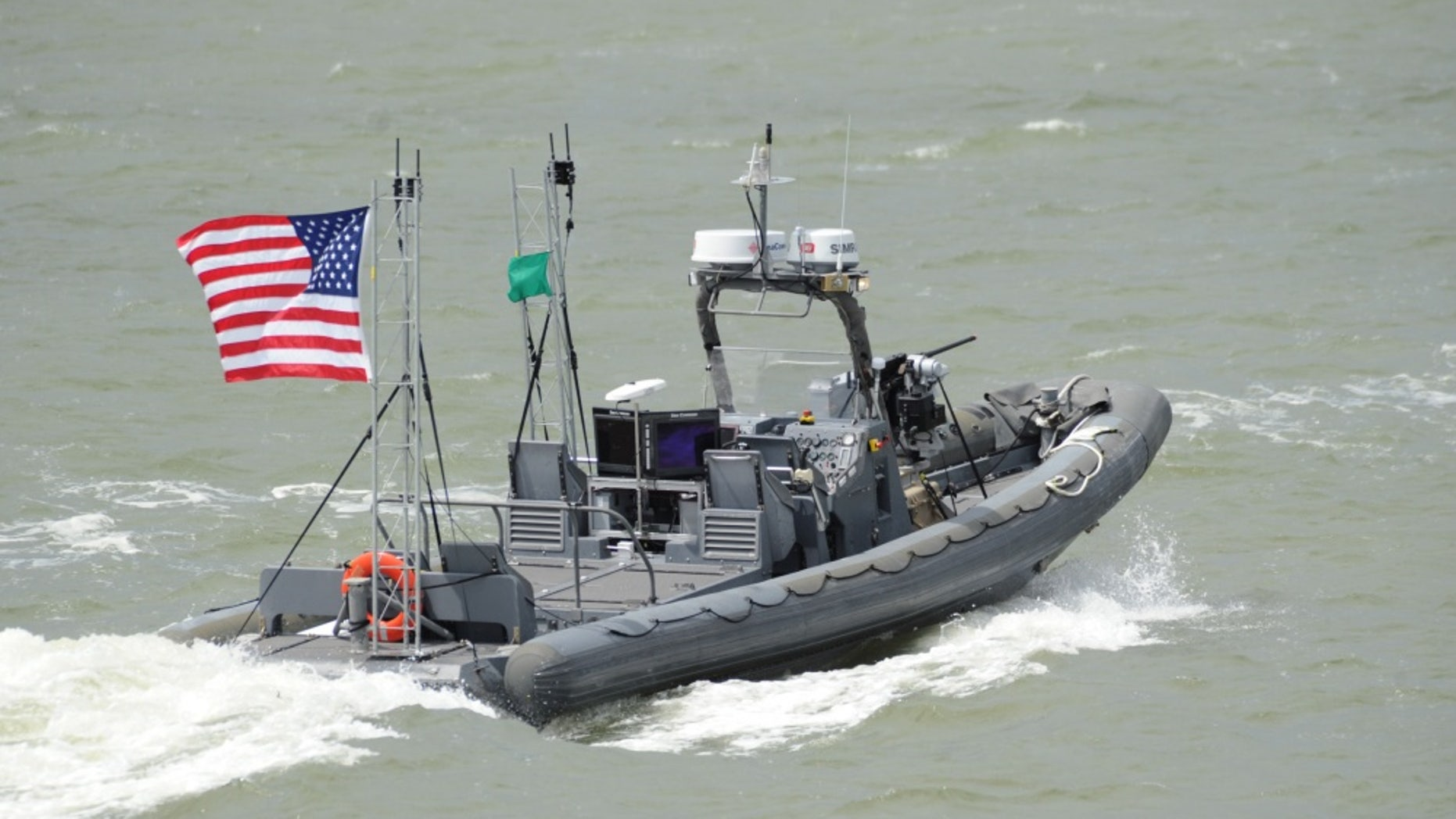 File photo - An unmanned 11-meter rigid-hull inflatable boat from Naval Surface Warfare Center Carderock operates autonomously during an Office of Naval Research-sponsored demonstration of swarmboat technology on the James River in Newport News, Va.(U.S. Navy photo by John F. Williams/Released)