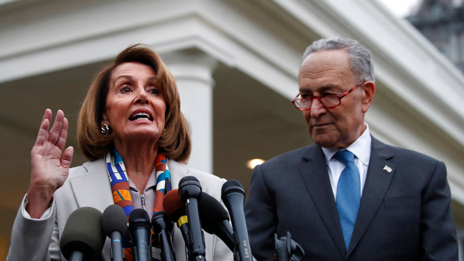 House Democratic leader Nancy Pelosi of California, left, the House Speaker-designate, and Senate Minority Leader Chuck Schumer, D-N.Y., speak to the media after meeting with President Donald Trump, Wednesday, Jan. 2, 2019, on border security at the White House in Washington. (AP Photo/Jacquelyn Martin)