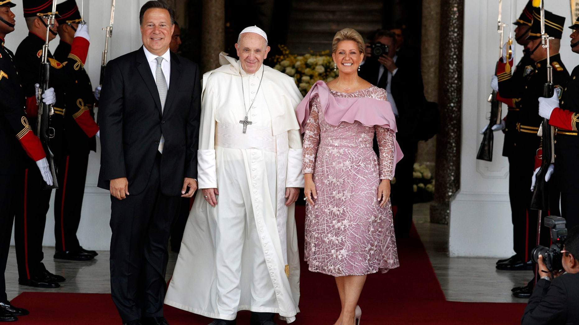Pope Francis, Panama's President Juan Carlos Varela and first lady Lorena Castillo pose for a photo at entrance of the presidential palace in Panama City, Thursday. (AP Photo/Rebecca Blackwell)