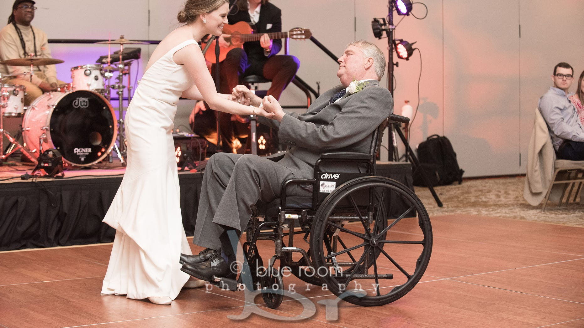 Mary Bourne Butts (née Roberts) dances with her father Jim. (Blue Room Photography)