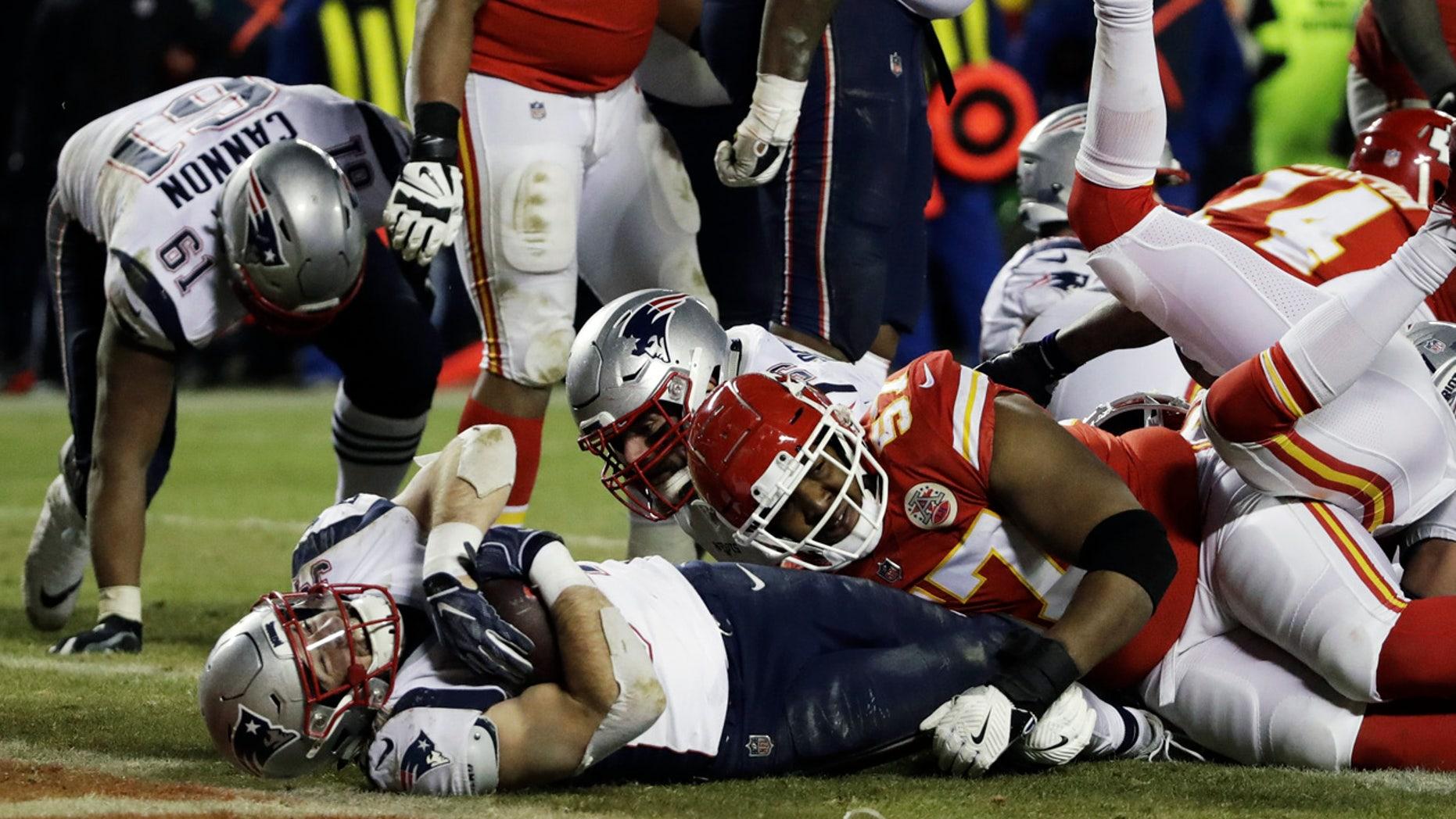 Rex Burkhead goes in for the winning score in overtime. (AP Photo/Elise Amendola)