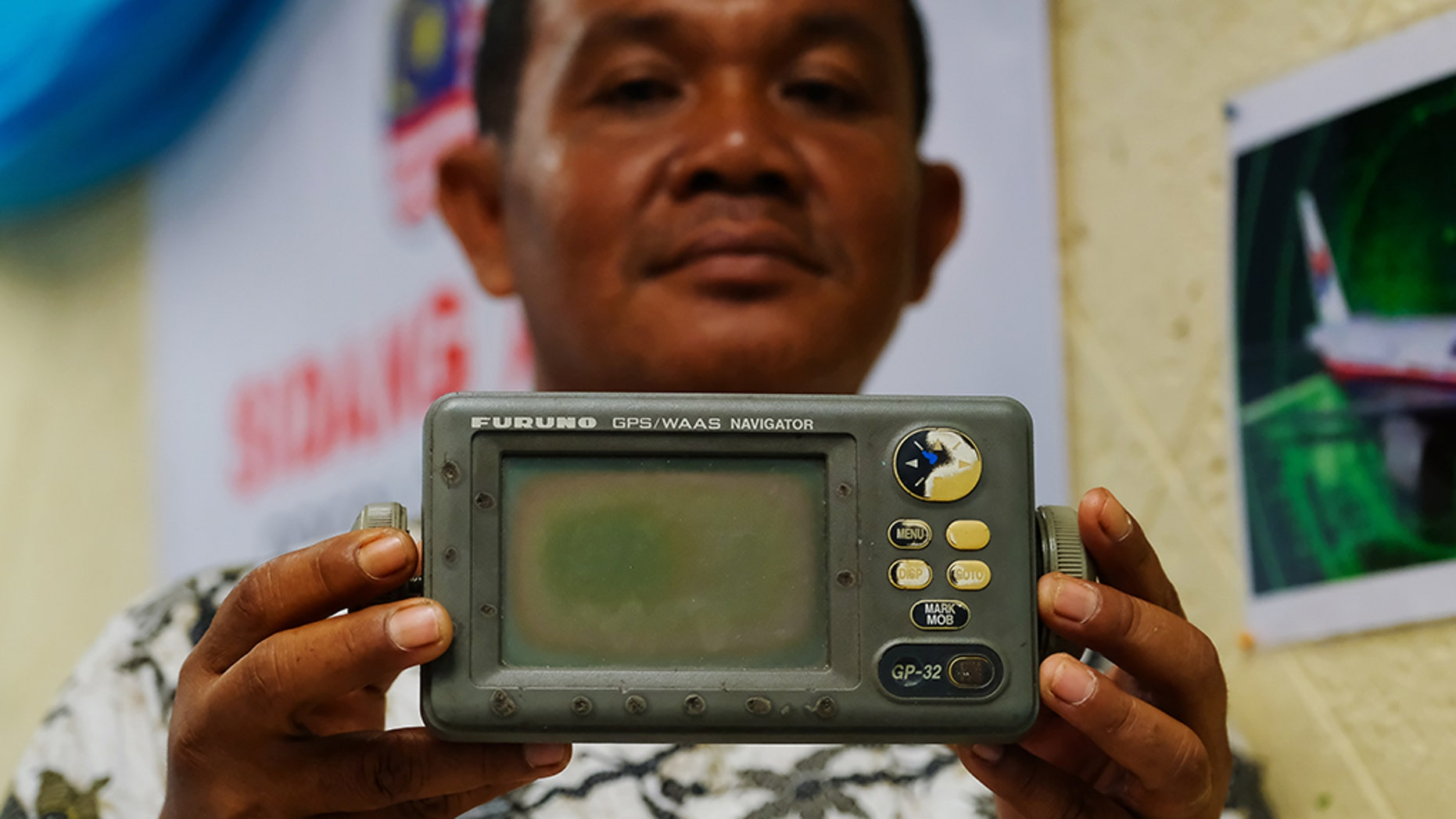 Rusli Khusmin, 42, a fisherman from Indonesia shows his GPS Navigator which he used to record the coordinates of where he believes Malaysia Airlines Flight MH370 crashed into the Sumatra Indonesia Sea during a news conference on January 16, 2019 in Subang Jaya outside Kuala Lumpur, Malaysia.