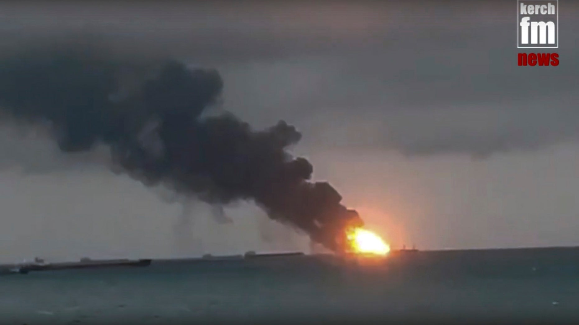 In this video grab provided by the Kerch.fm web portal, the two vessels, the Maestro and the Candy, were burning near the Kerch Strait linking the Black Sea and the Sea of Azov on Monday. (Kerch.fm via AP)