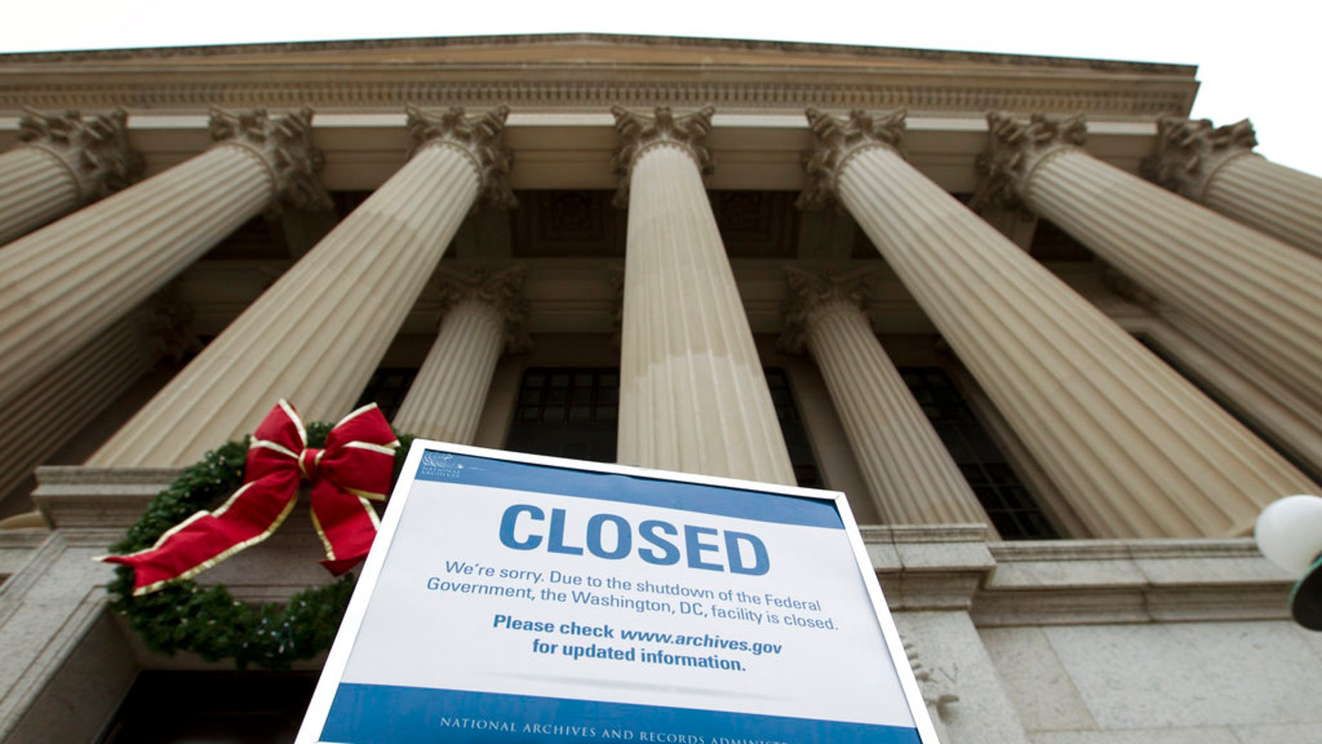 A closed sign is displayed at The National Archives entrance in Washington, Tuesday, Jan. 1, 2019, as a partial government shutdown stretches into its third week. A high-stakes move to reopen the government will be the first big battle between Nancy Pelosi and President Donald Trump as Democrats come into control of the House. (AP Photo/Jose Luis Magana)