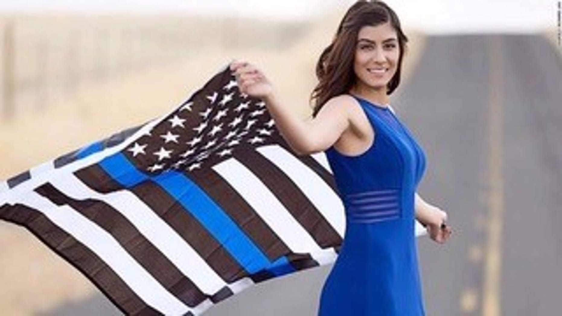 Battled California police, Natalie Corona, in a 2016 photo film containing a thin blue line flag.