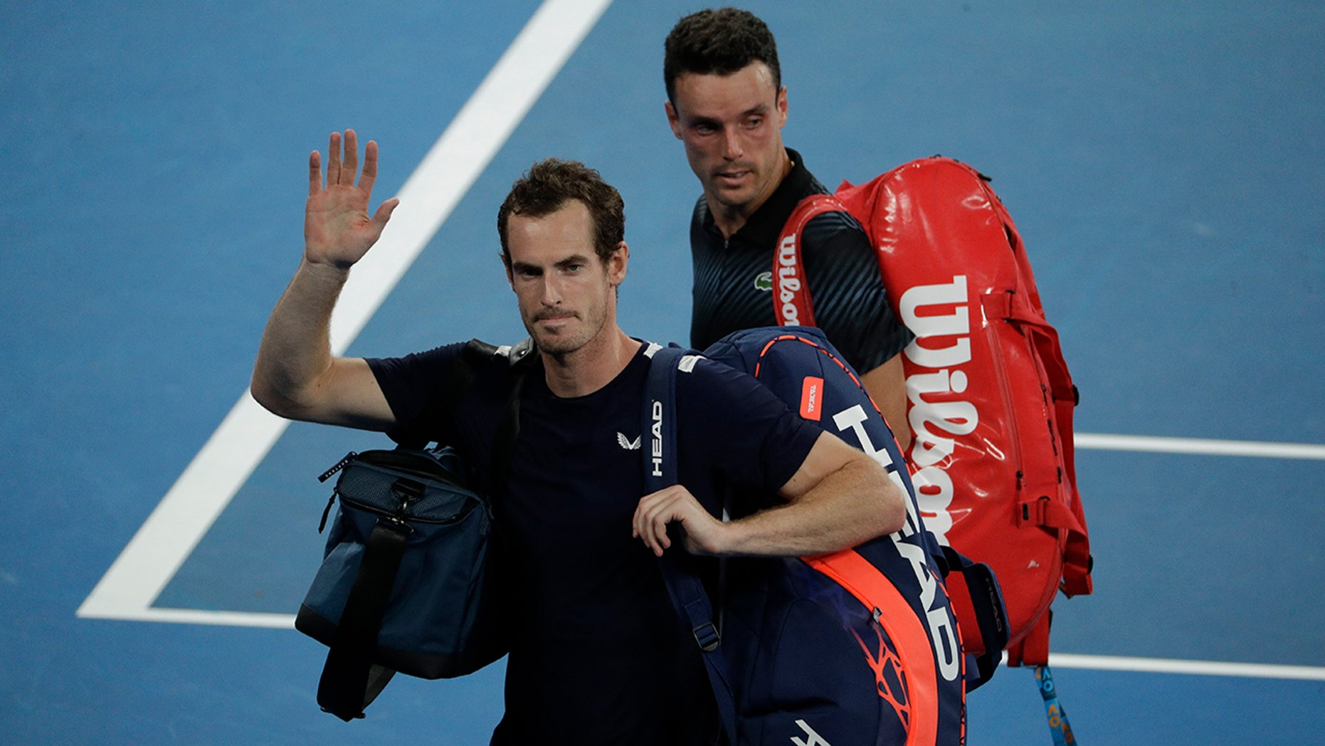 Britain's Andy Murray waves as he leaves the court following his first round loss to Spain's Roberto Bautista Agut at the Australian Open tennis championships in Melbourne, Australia, Monday, Jan. 14, 2019.