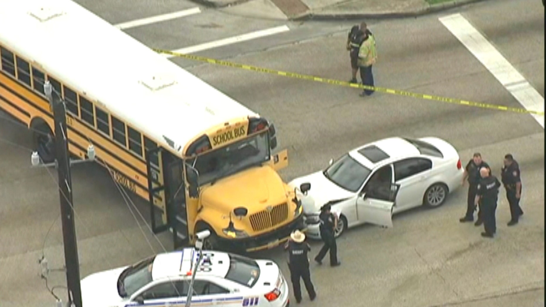 A man with a gunshot wound passed out behind the wheel of a white BMW and crashed into a bus full of middle school students in Texas.