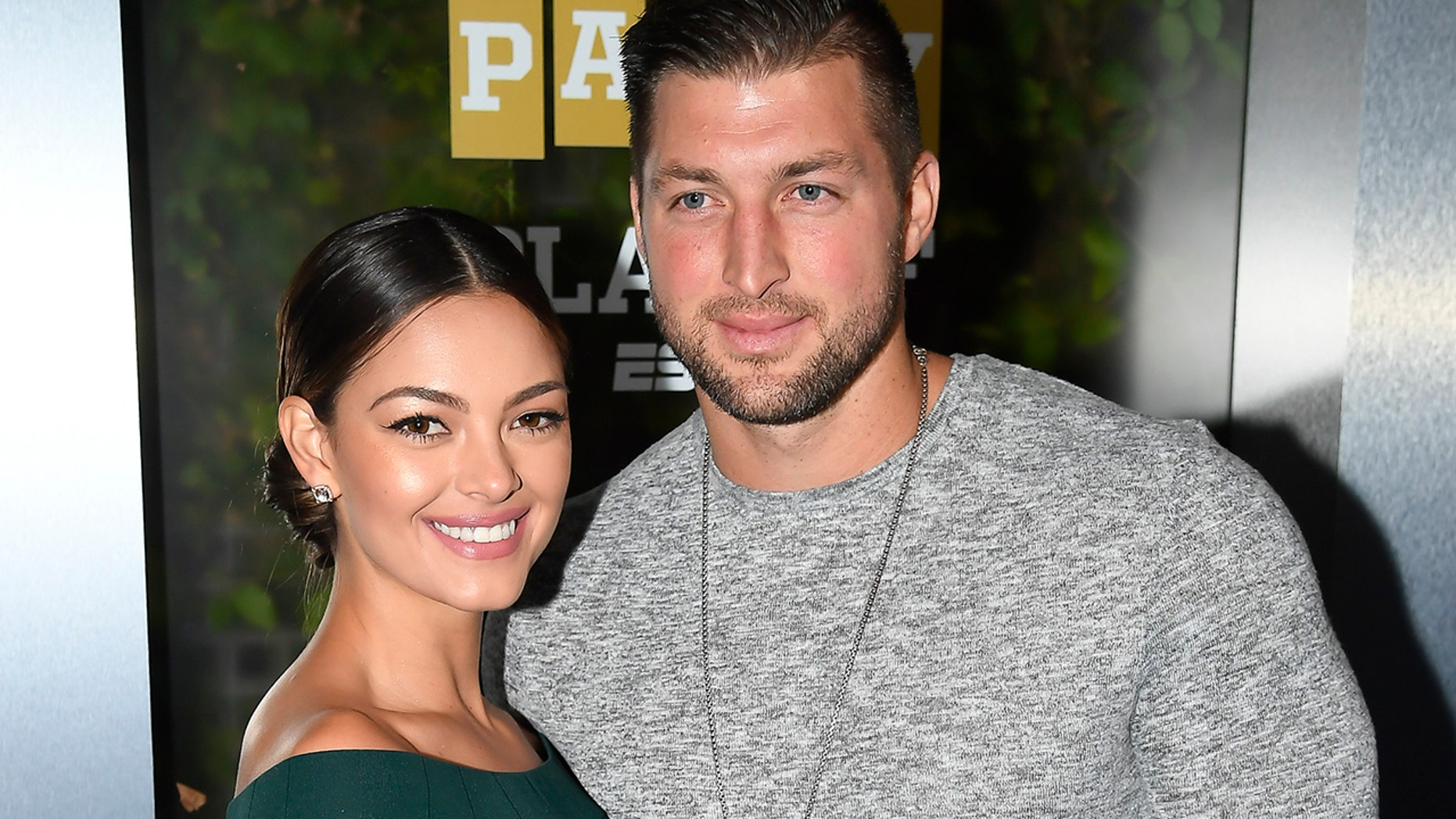 Miss Universe 2017 Demi-Leigh Nel-Peters and Tim Tebow of ESPN attend the Party At The Playoff at The GlassHouse on January 5, 2019 in San Jose, California. The couple became engaged in January 2019.