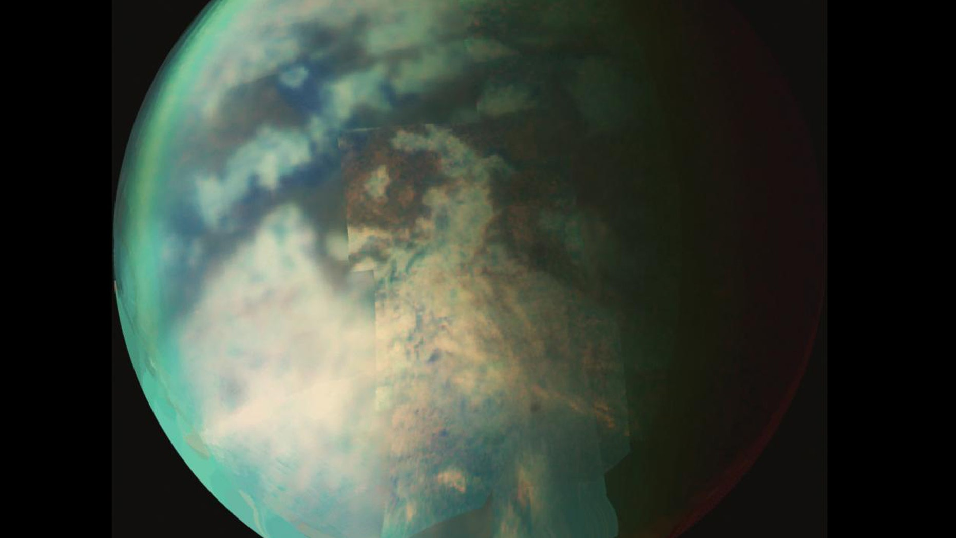 New research provides evidence of rainfall on the north pole of Titan, the largest of Saturn's moons, shown here. (Credit: NASA/JPL/University of Arizona)