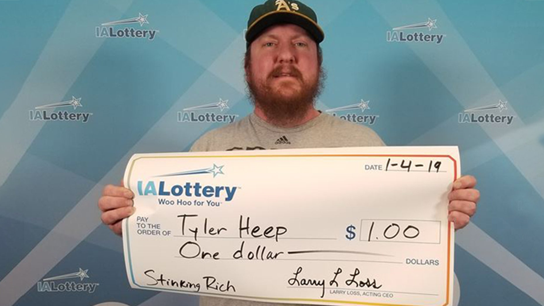 """Tyler Heep, of Iowa, said he asked state lottery officials for """"one of those big ceremonial checks"""" after he won $1 via a scratch-off ticket."""