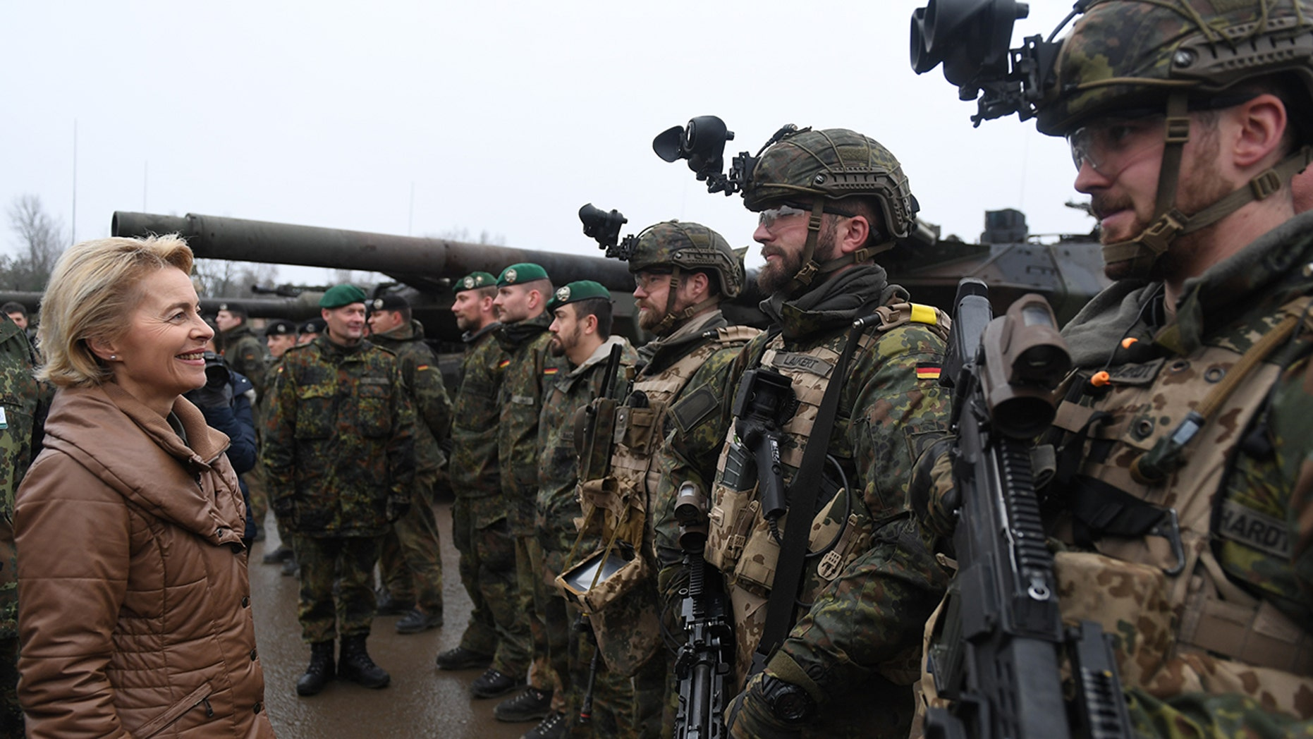 German Defense Minister Ursula von der Leyen chats with soldiers of the Bundeswehr during a visit to a Bundeswehr infantry training facility on December 6, 2018 in Munster, Germany.