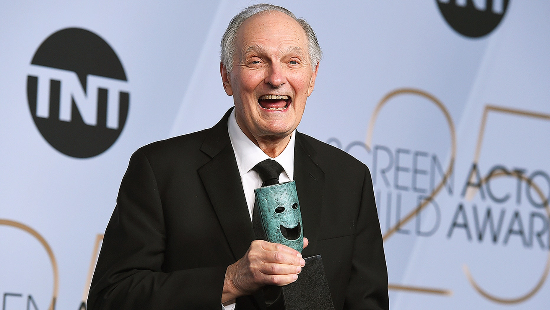 Alan Alda poses with the Life Achievement Award in the press room at the 25th annual Screen Actors Guild Awards.
