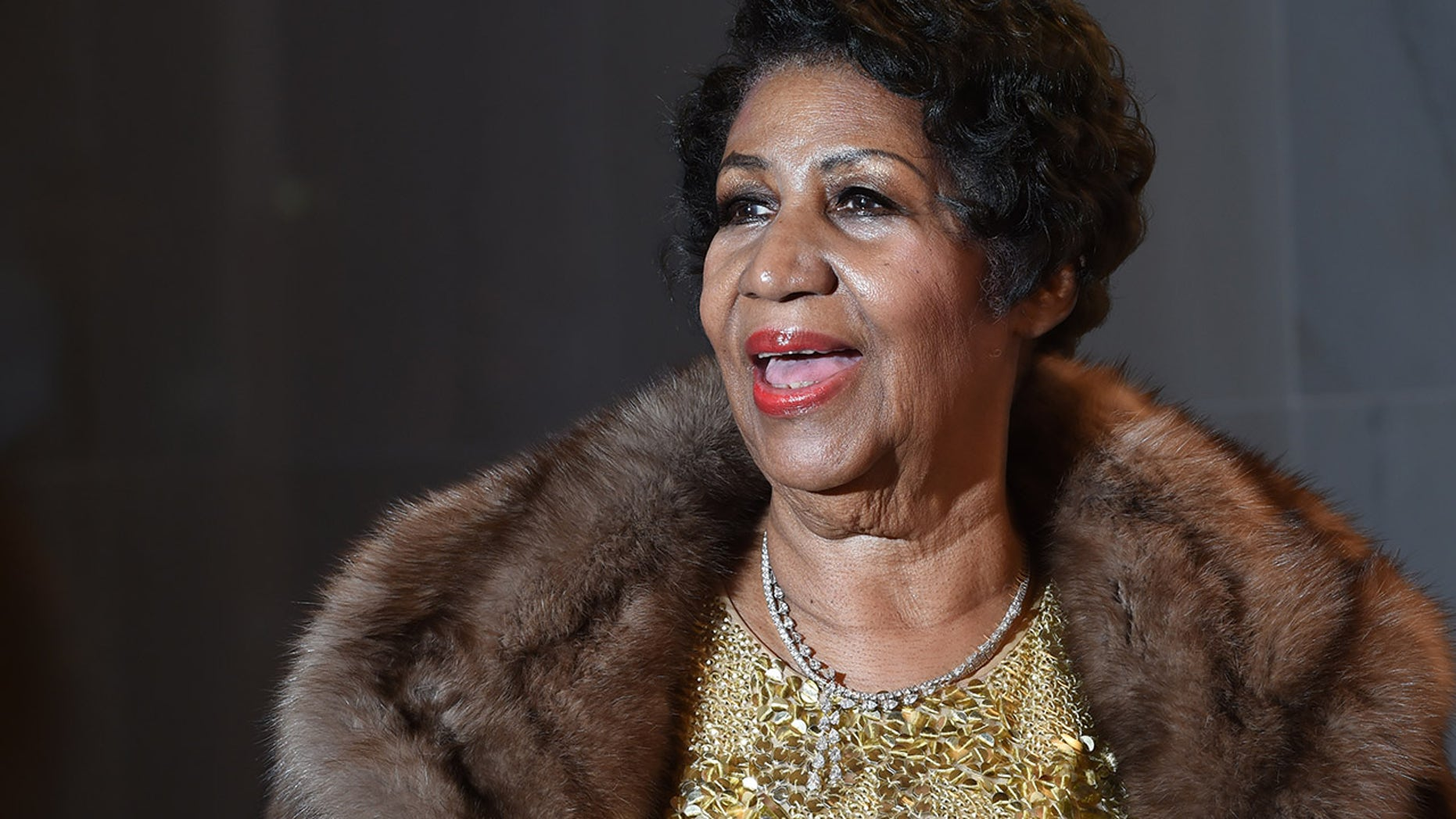 Aretha Franklin poses on the red carpet before the 38th Annual Kennedy Center Honors December 6, 2015 in Washington, DC.
