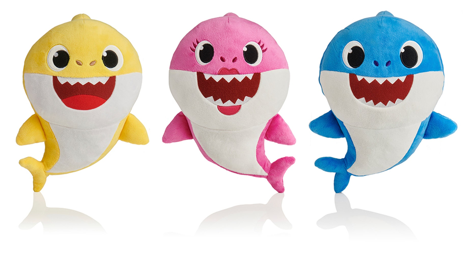 """This picture shows the WowWee pinkfong Baby Shark family of singing plush toys.""""Baby Shark,"""" the wildly popular children's YouTube video that dives into a song about sharks, has landed on the Billboard Hot 100 chart this week."""