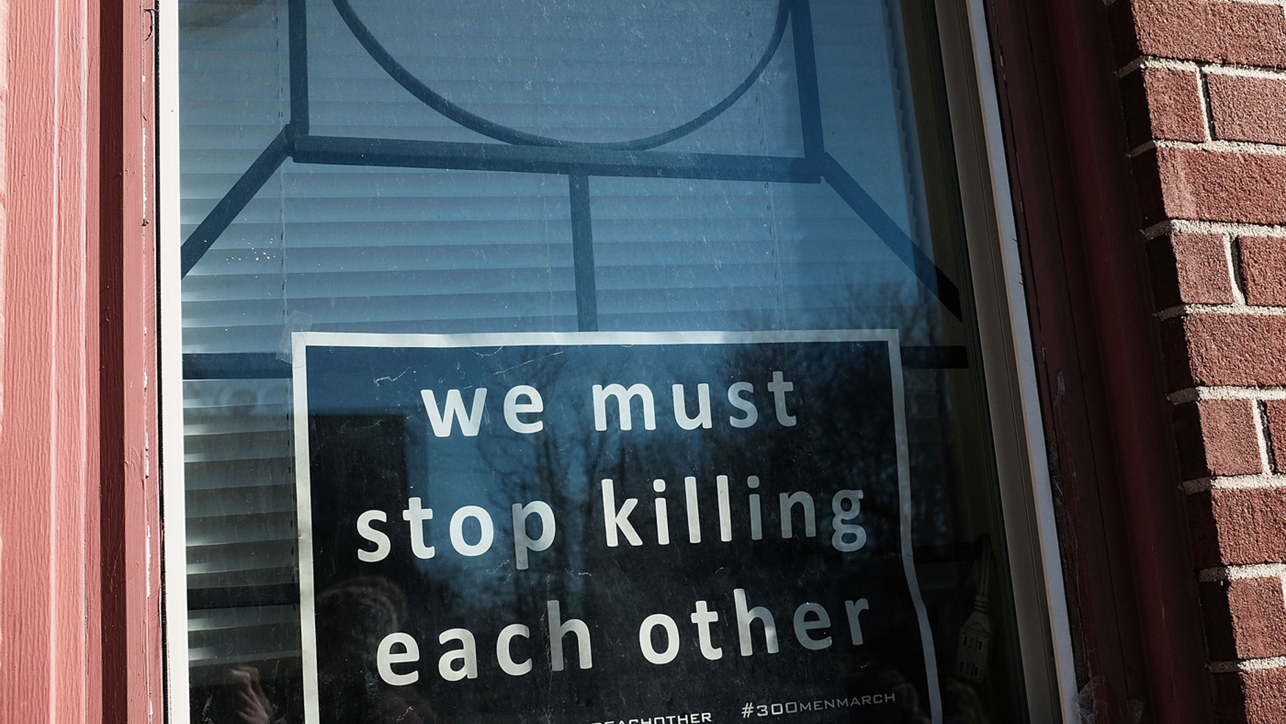 BALTIMORE, MD - FEBRUARY 03: A sign to end violence sits in a window in a neighborhood with a high murder rate on February 3, 2018 in Baltimore, Maryland.