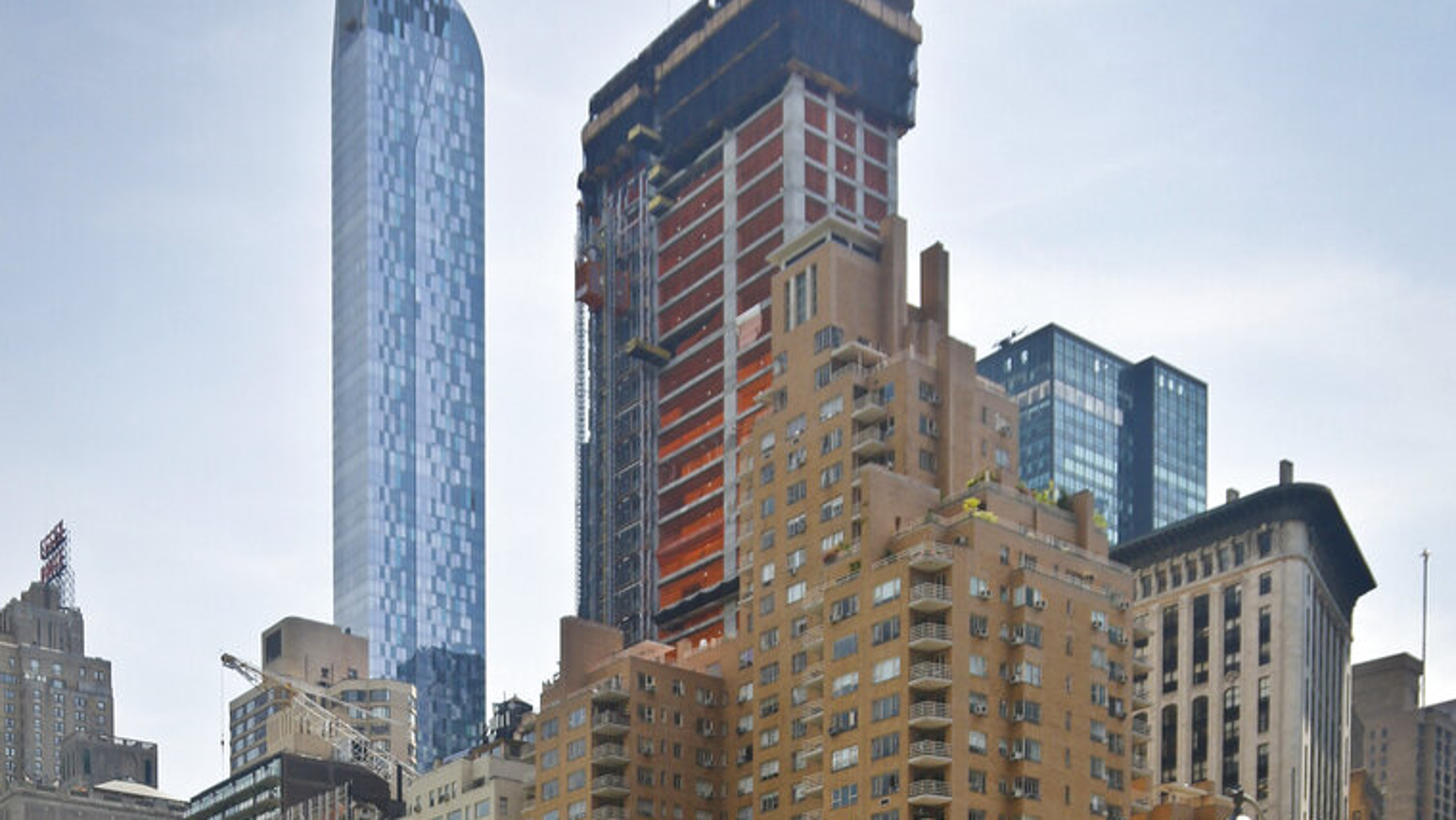 FILE: A crane sits on top of the ongoing construction of a new condominium skyscraper at 220 Central Park South in New York.