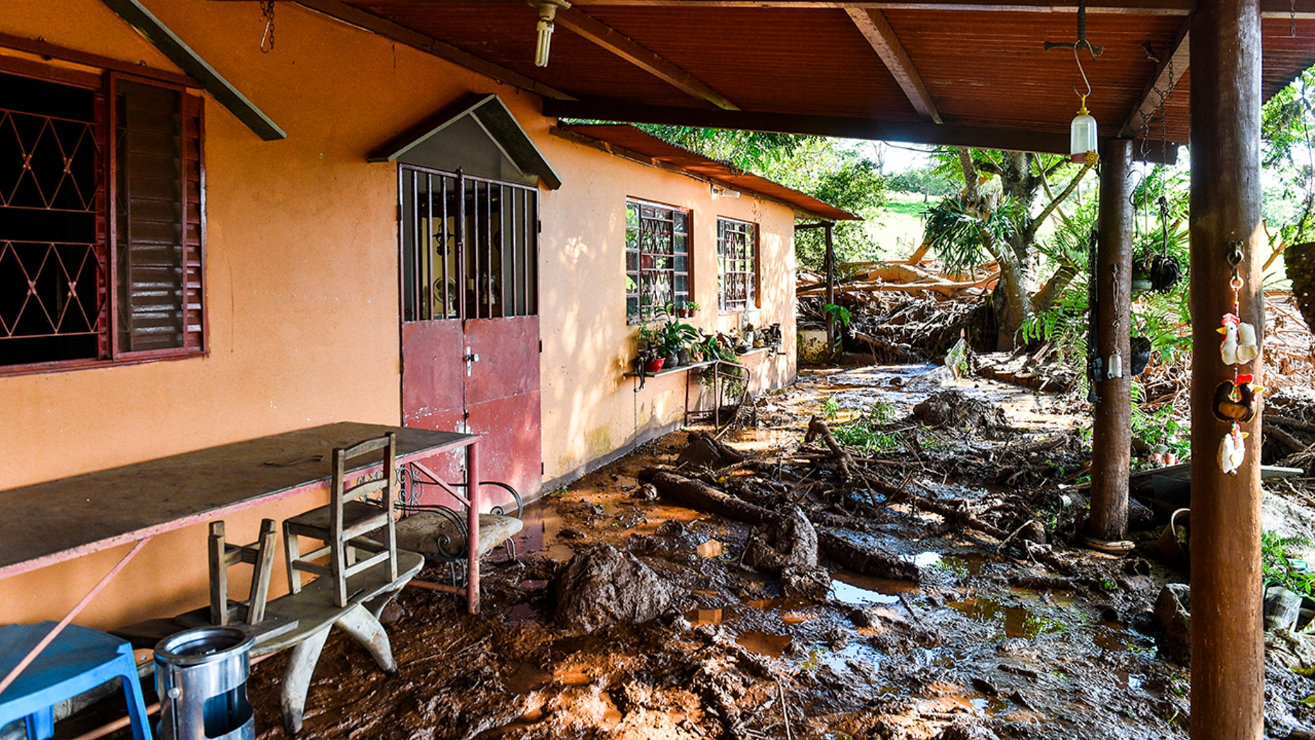 A house struck by the mud in southeastern Brazil on Jan.27, a day after the dam collapse. (Photo by Pedro Vilela / Getty Images)