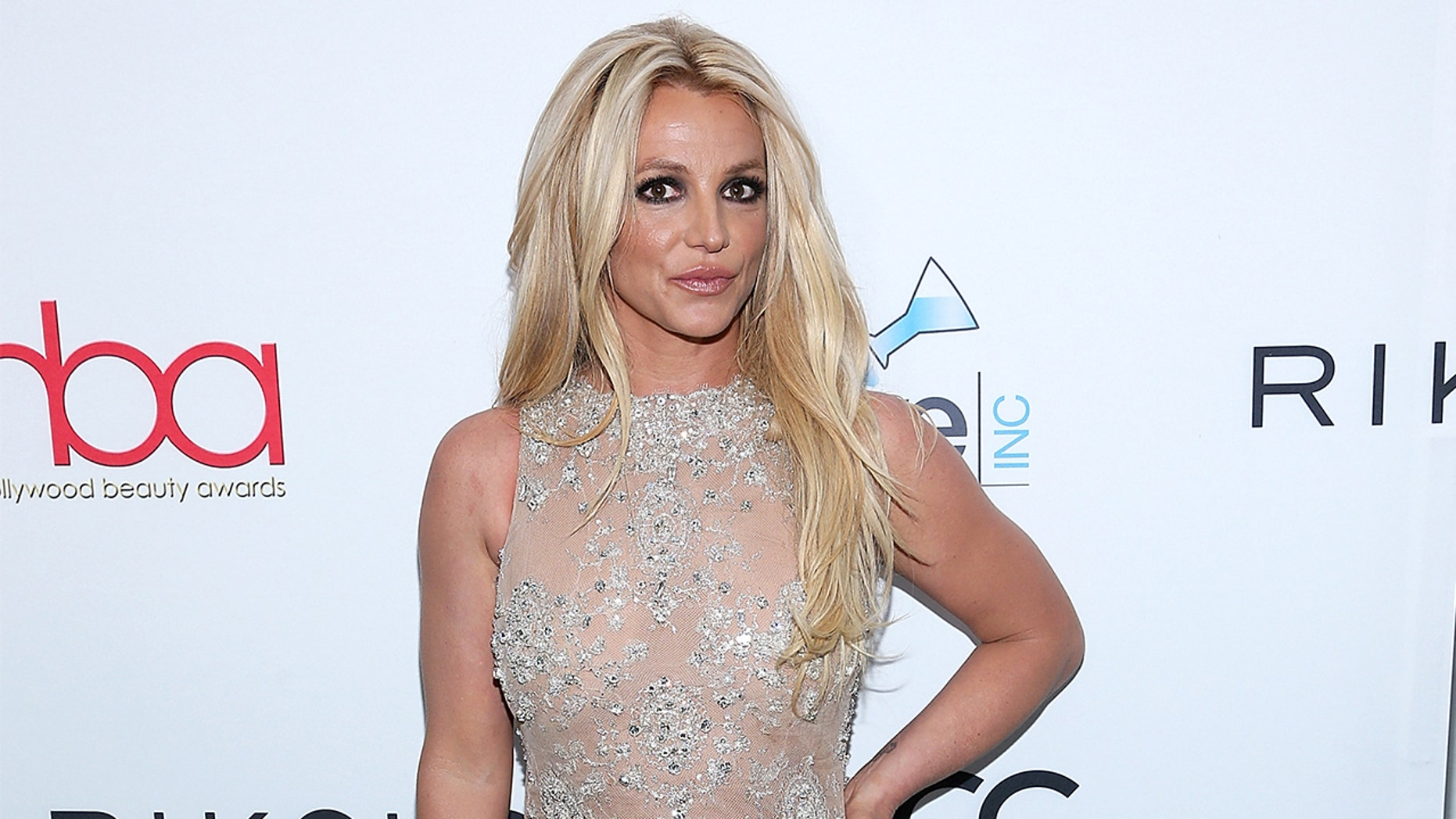 Britney Spears announced on Friday she is taking an indefinite work hiatus to be by her father's side amid his illness.