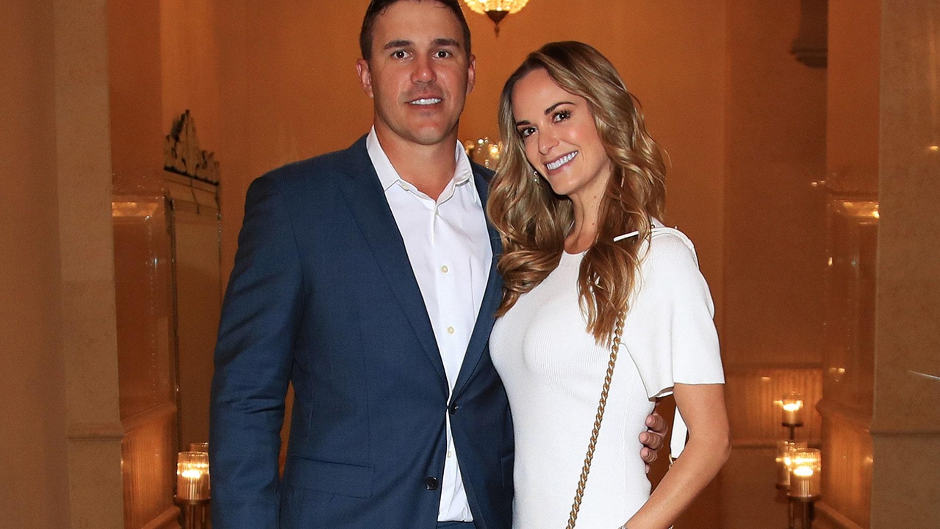 Brooks Koepka of the United States and girlfriend Jena Sims pose for a photo ahead of the Abu Dhabi HSBC Golf Championship at the Abu Dhabi Golf Club on January 14, 2019 in Abu Dhabi, United Arab Emirates.