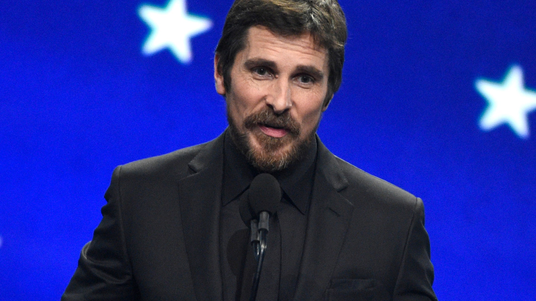 Christian Bale accepts a endowment for best actor for Vice during a 24th annual Critics' Choice Awards on Sunday, Jan. 13, 2019, during a Barker Hangar in Santa Monica, Calif.