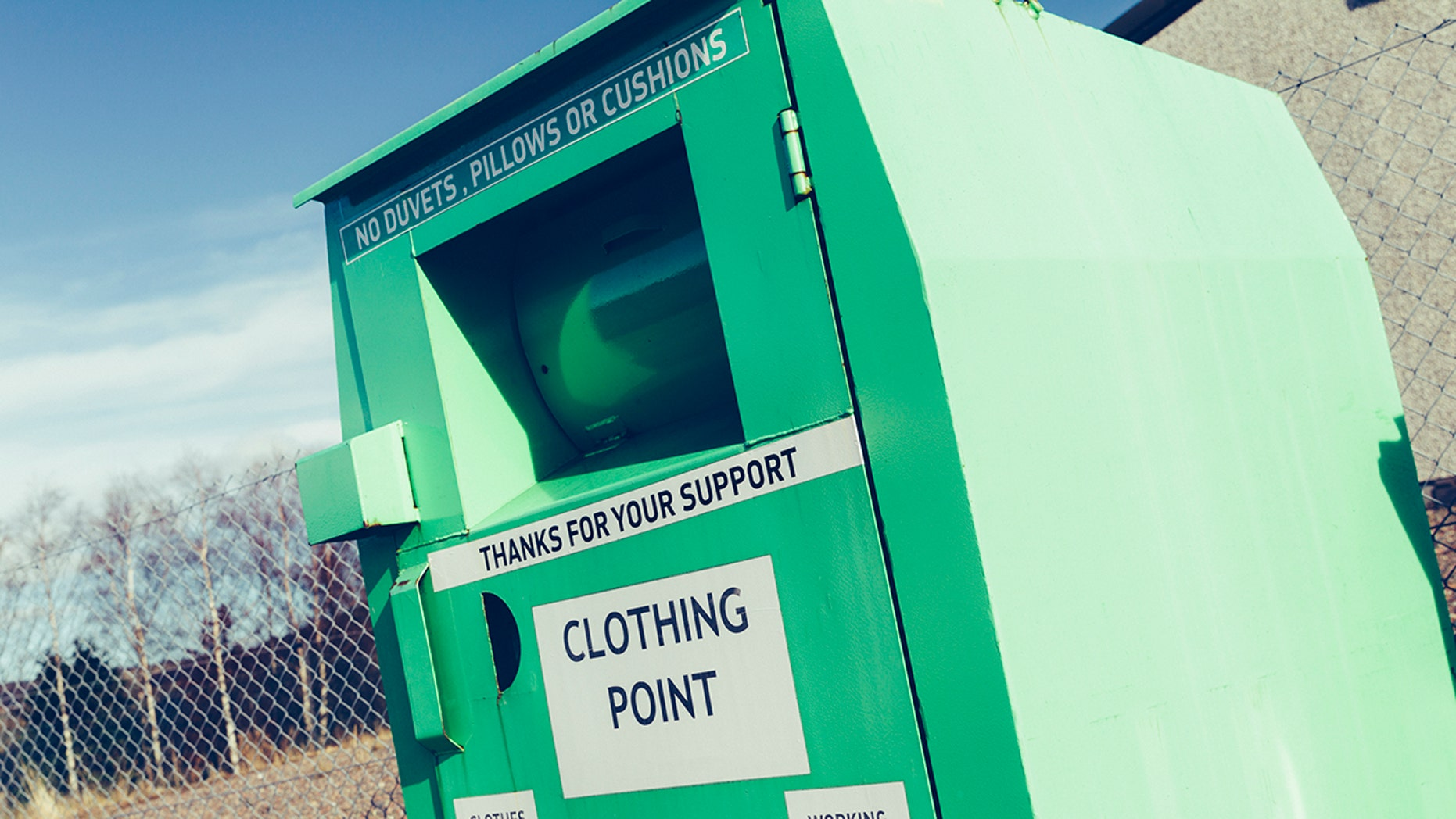 A woman found stuck partially inside a clothing donation bin was pronounced dead Tuesday, Toronto Police said.