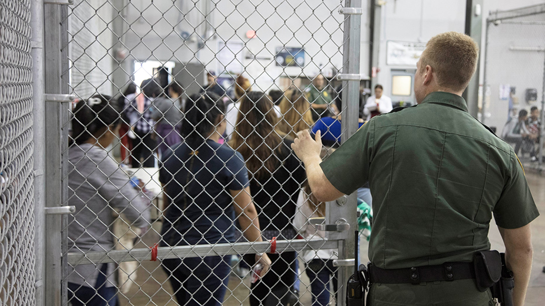 A view of inside U.S. Customs and Border Protection (CBP) detention facility shows detainees inside fenced areas at Rio Grande Valley Centralized Processing Center in Rio Grande City, Texas, in June.