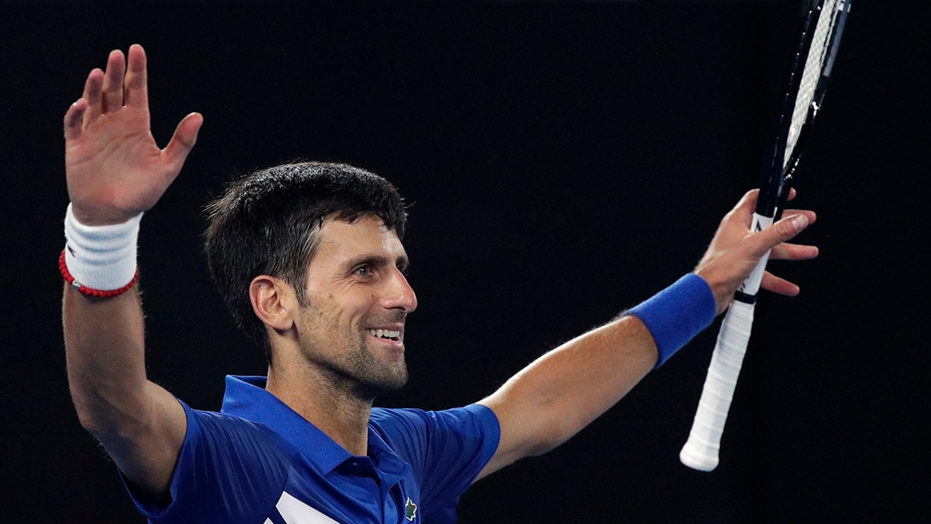 "Serbia's Novak Djokovic celebrates after defeating Spaniard Rafael Nadal in the men's final at the Australian Open Tennis Championships in Melbourne, Australia on Sunday, January 27, 201<div class=""e3lan e3lan-in-post1""><script async src=""//pagead2.googlesyndication.com/pagead/js/adsbygoogle.js""></script> <!-- Text_Display_Ad --> <ins class=""adsbygoogle""      style=""display:block""      data-ad-client=""ca-pub-7542518979287585""      data-ad-slot=""2196042218""      data-ad-format=""auto""></ins> <script> (adsbygoogle = window.adsbygoogle || []).push({}); </script></div>9. (Associated Press)"