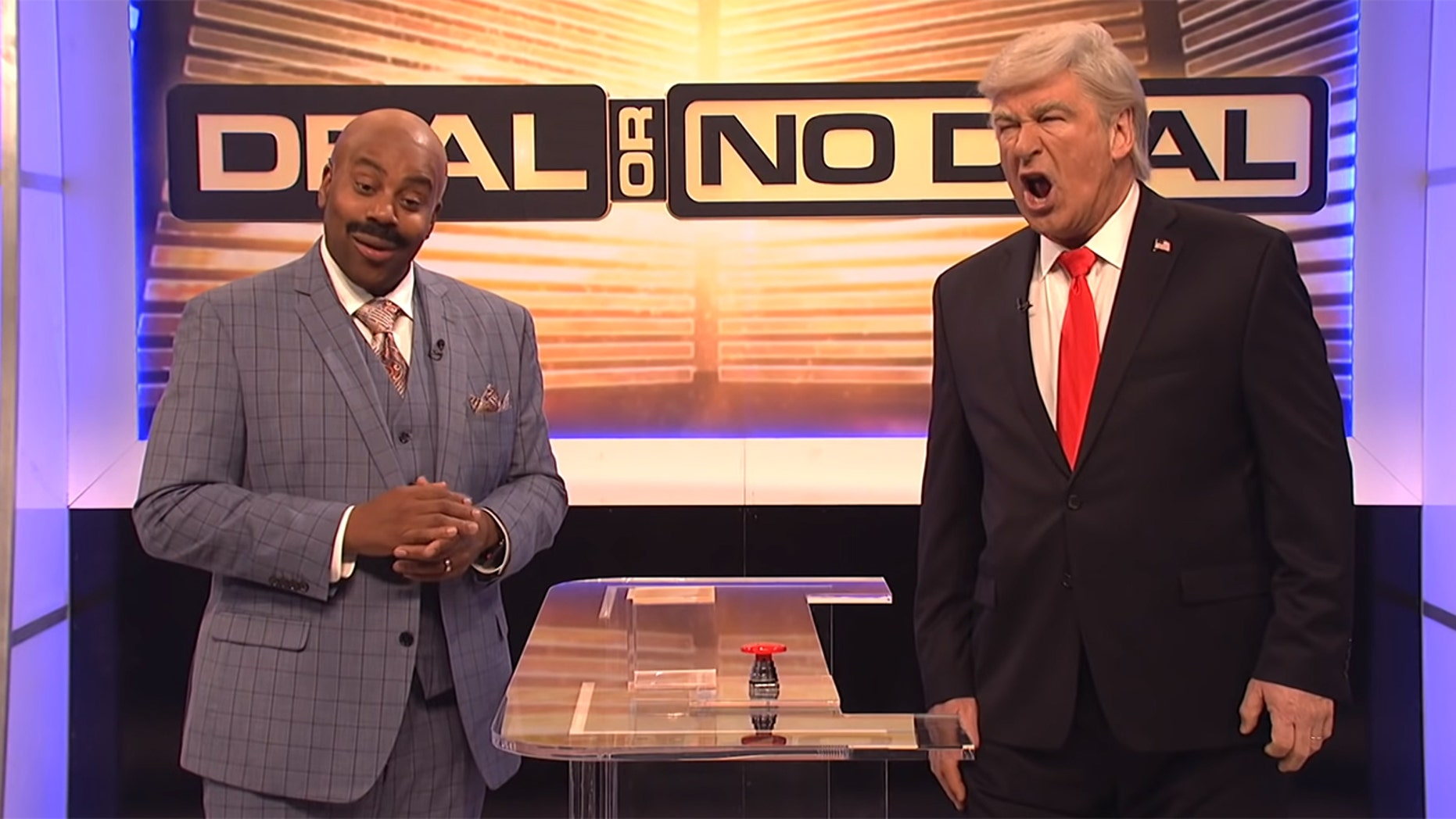 "Kenan Thompson as Steve Harvey and Alec Baldwin as Donald Trump in ""Saturday Night Live"" sketch ""Deal or No Deal: Government Shutdown Edition"""