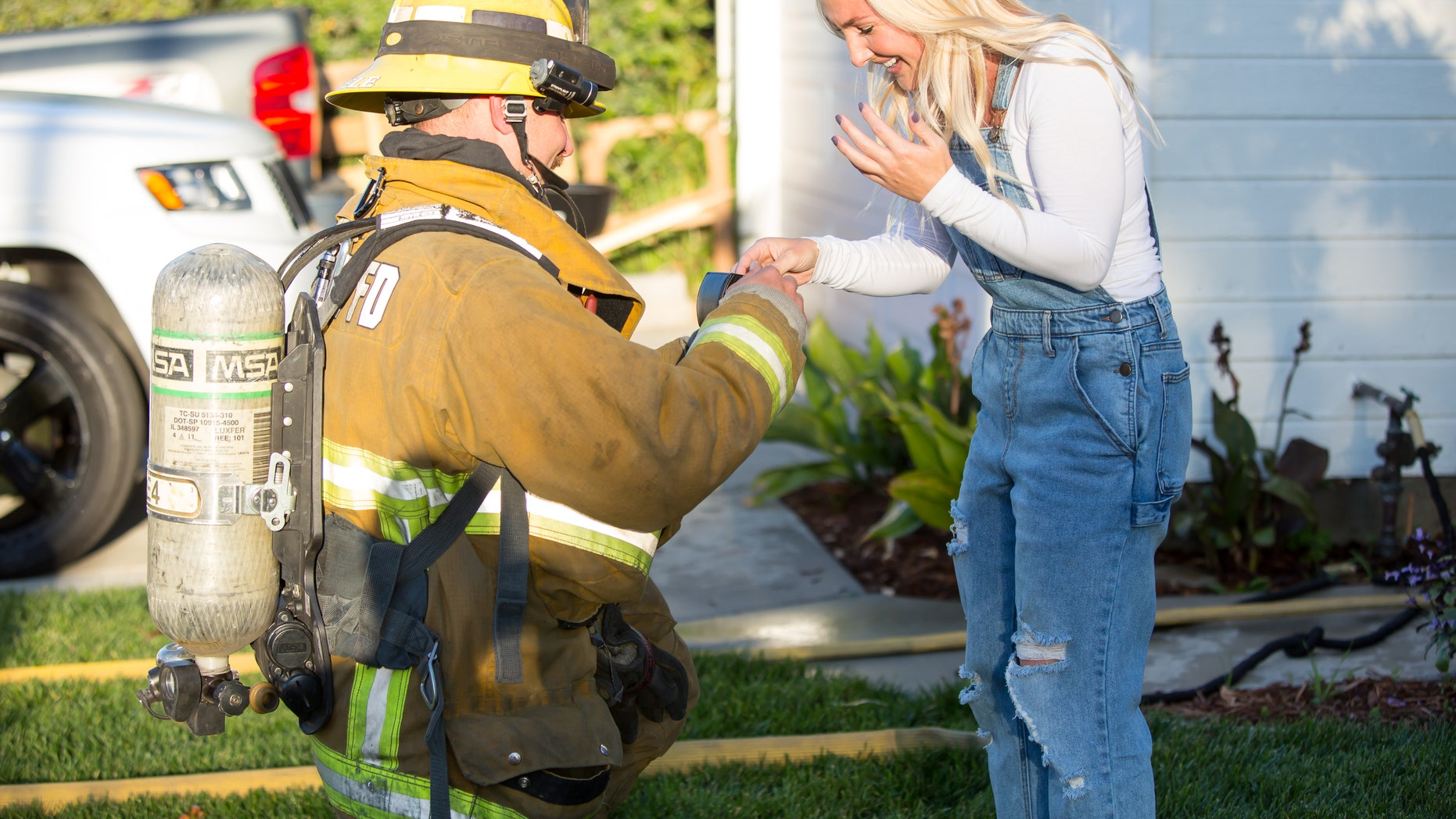 Fireman fiance Zach Steele, 30, proposes to girlfriend Maddison Ridgik, 30, after he faked a fire using smoke machines to create a surprise proposal at their home.