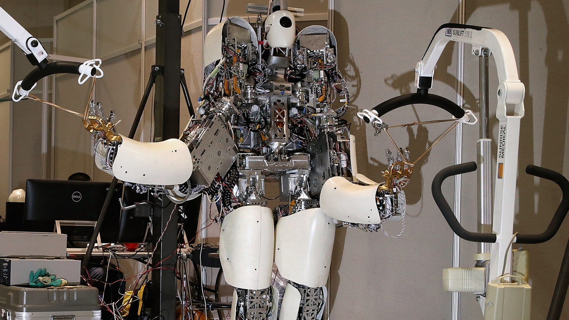 Team NEDO-Hydra's robot is held in place by racks inside the Robot Garage during the Defense Advanced Research Projects Agency (DARPA) Robotics Challenge, June 6, 2015 in Pomona, California.