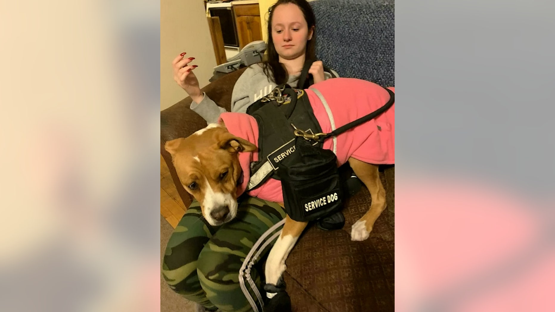 Baker's service dog can sniff out life-threatening odors, as well as alert to her an oncoming reaction.