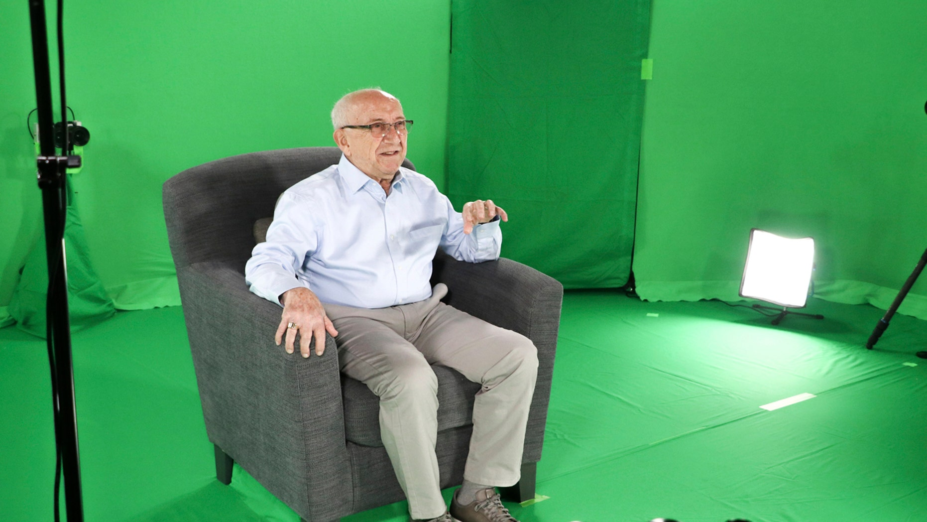 This August 2018 photo shows Holocaust survivor Max Glauben sitting in an interactive green screen room while filming a piece for the Dallas Holocaust Museum in Dallas.