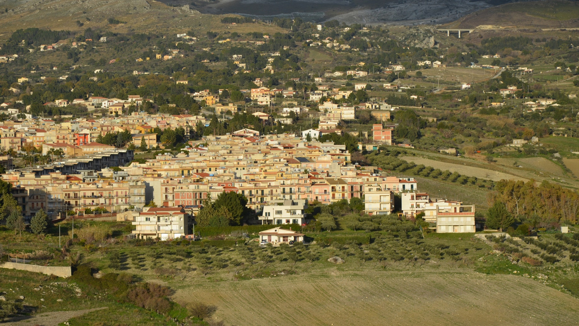Local officials on southern Italy's island of Sicily have put dozens of hilltop homes on the market.