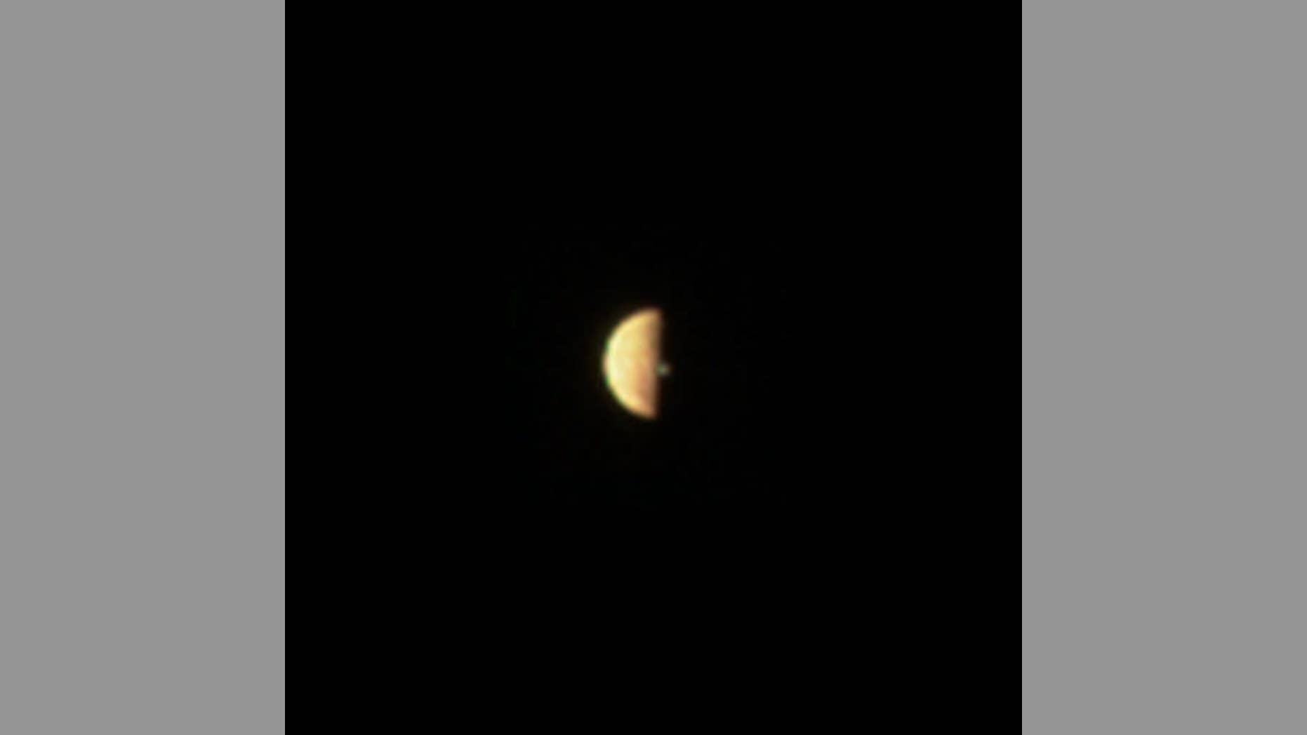 Juno's visible light camera, JunoCam, spotted a volcanic plume right along Io's terminator, the line between the daylight side and the night side. The spacecraft was 186,000 miles (300,000 kilometers) away from the moon.