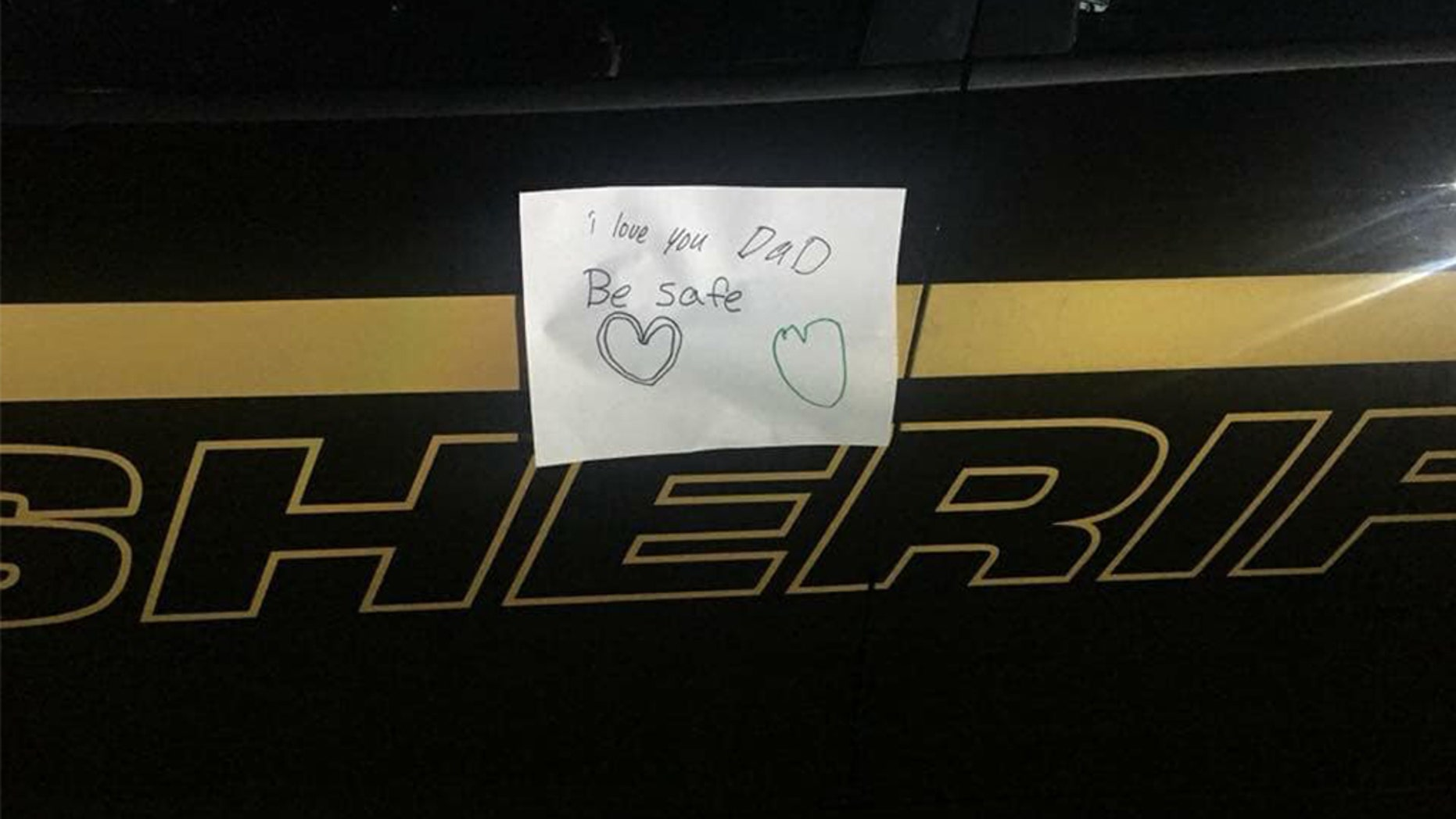 "The Brunswick County Sheriff's Office in North Carolina reported a ""sweet note was left on the patrol car of one of our deputies by his children."" (Brunswick County Sheriff's Office)"