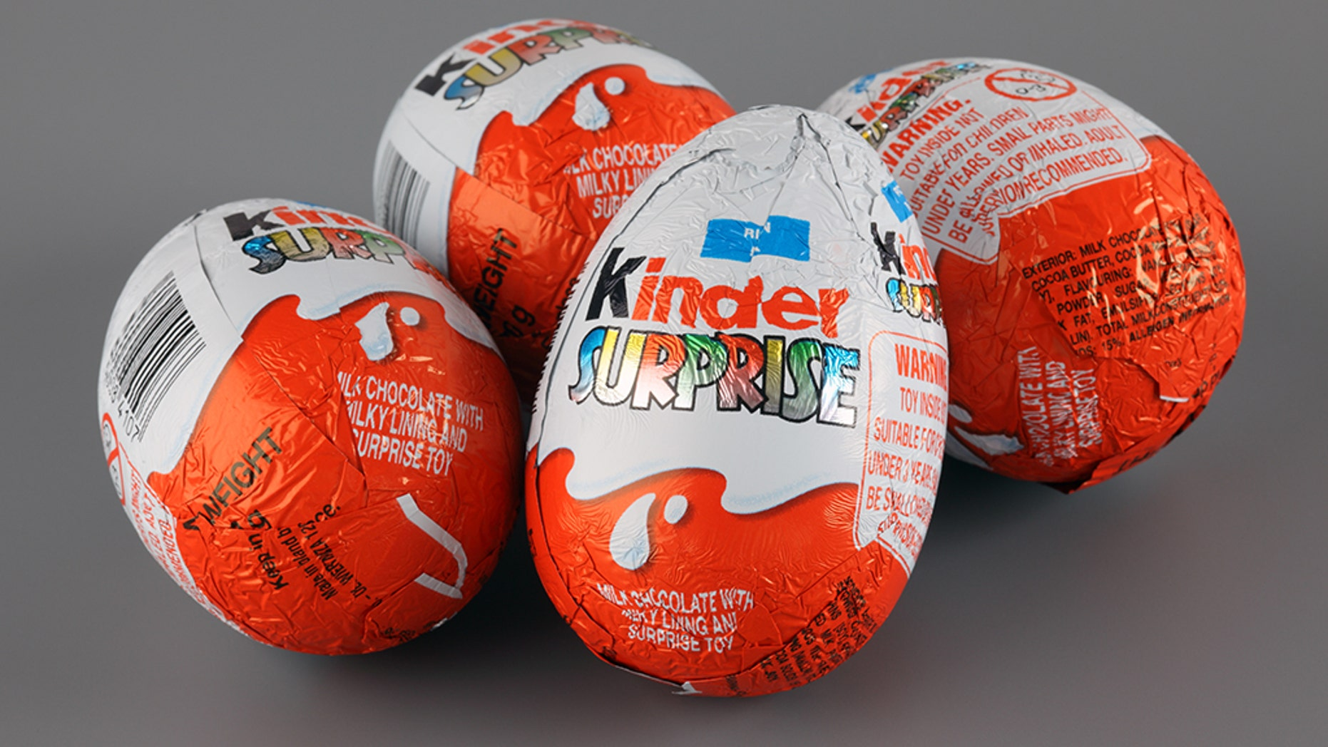 Each Kinder Surprise egg consists of a chocolate shell, a cosmetic capsule, a essence of pronounced capsule, and an outmost foil wrap.