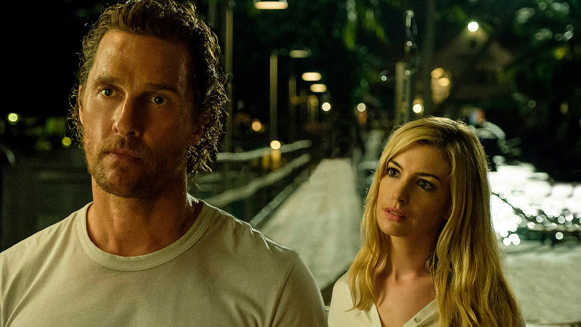 This picture published by Aviron Pictures shows Matthew McConaughey (left) and Anne Hathaway in one scene