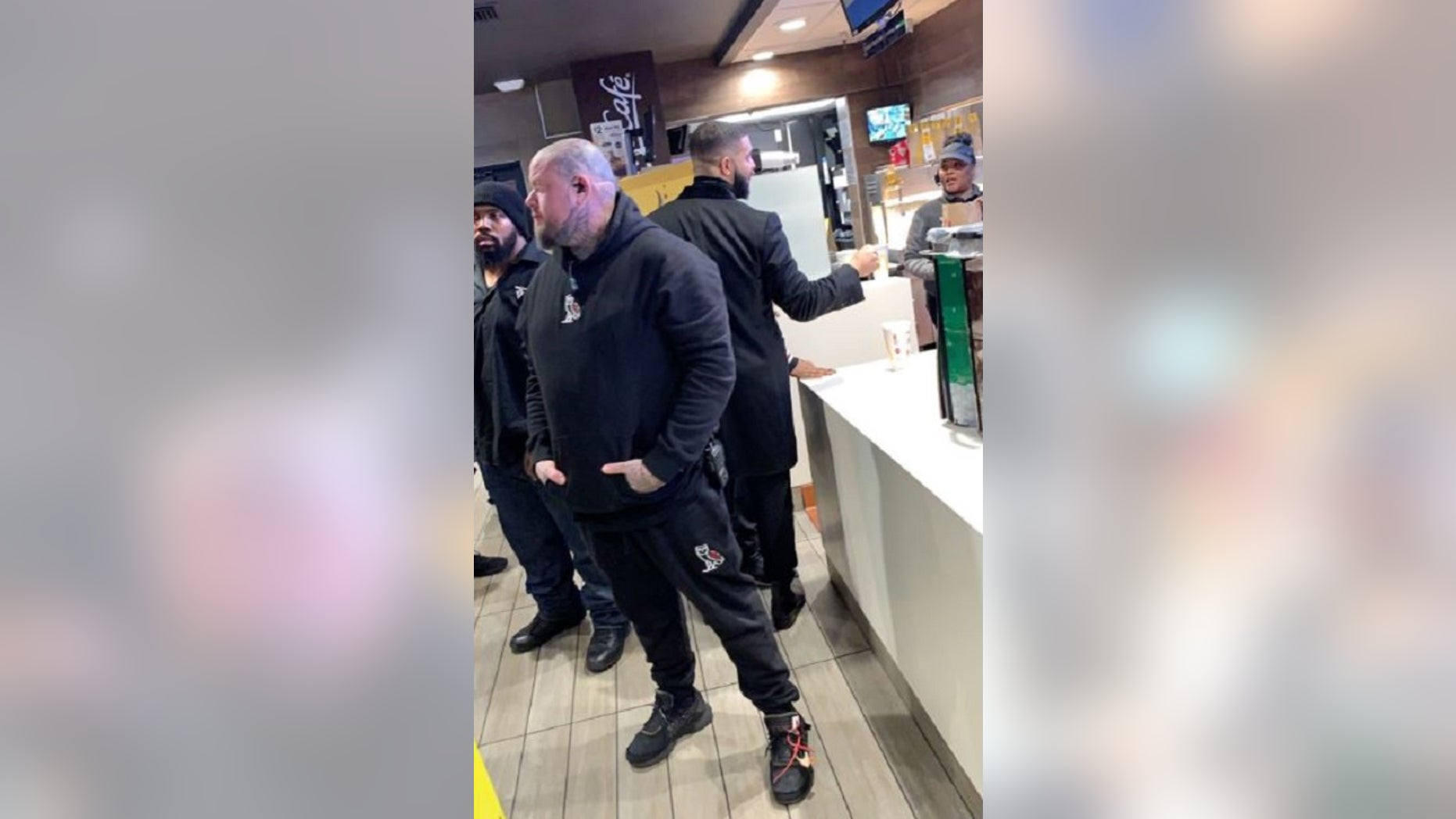 Drake appears to hand a hefty tip to McDonald's employees in Los Angeles last weekend.