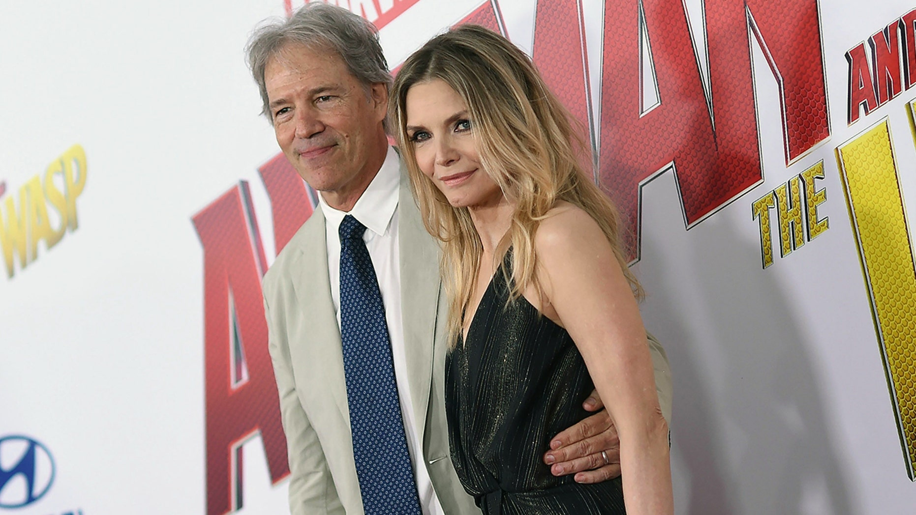 "David E. Kelley and Michelle Pfeiffer at the ""Ant-Man and the Wasp"" premiere"