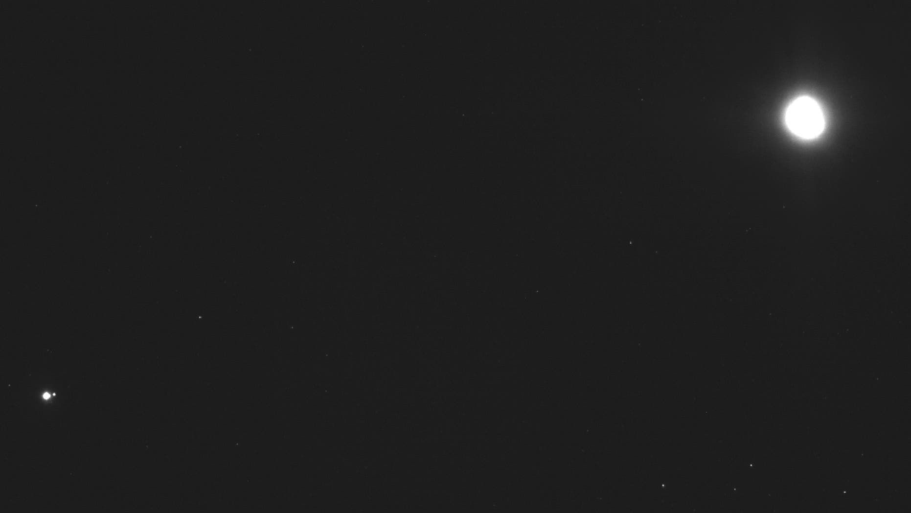 This image captured on Dec. 19, 2018, by a camera on the Osiris-Rex spacecraft shows the asteroid Bennu, top right, about 27 miles (43 kilometers) from the spacecraft, and the Earth and moon, bottom left, more than 70 million miles (110 million kilometers) away. Bennu, just 1,600 feet (500 meters) across, is the smallest celestial body ever to be orbited by a spacecraft. (NASA/Goddard/University of Arizona/Lockheed Martin Space via AP)