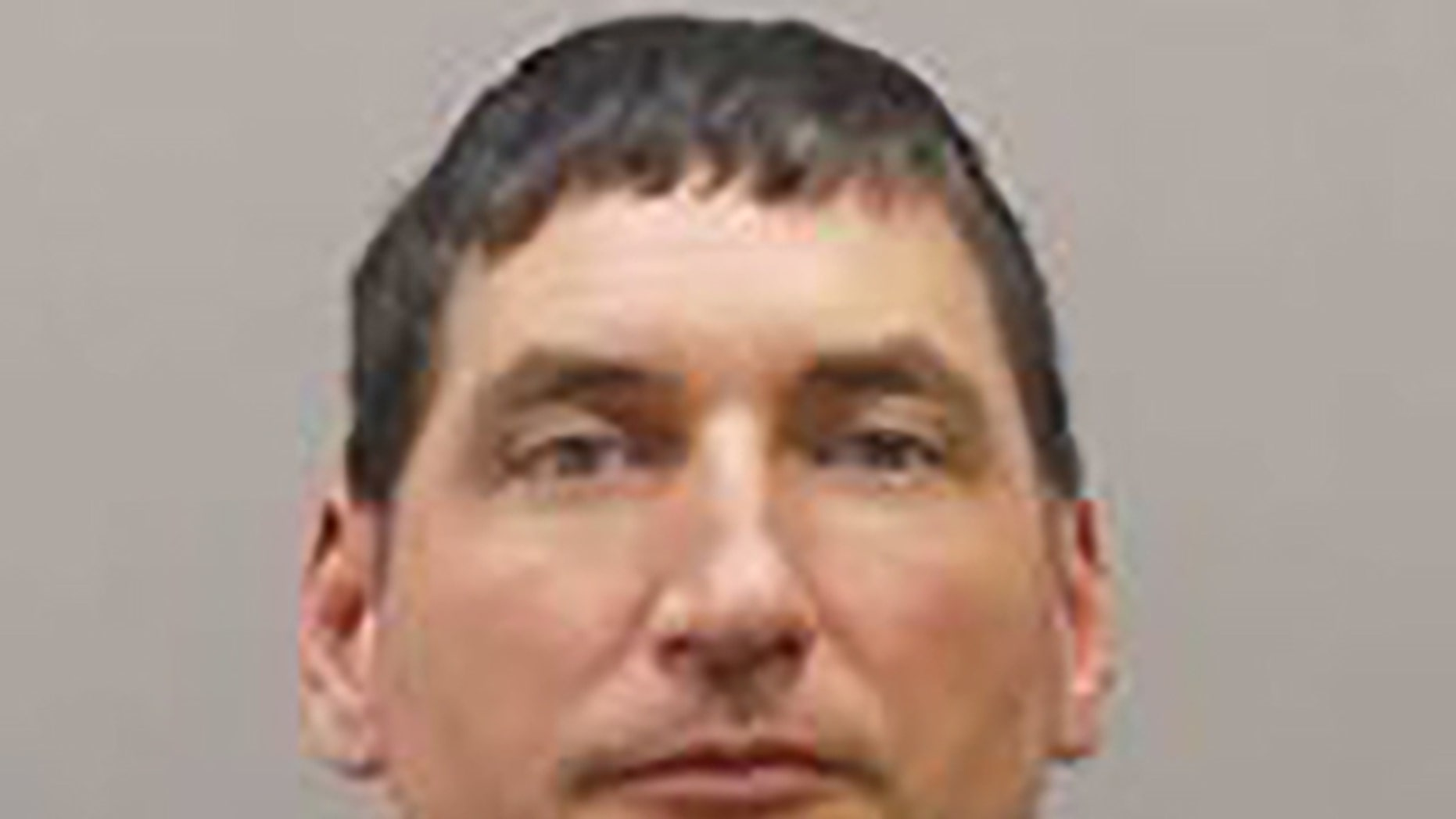 Paul Hicks, 43, turned himself in to authorities in Ohio on Wednesday for allegedly masterminding an 'elaborate' arson scheme intended to frame his ex-girlfriend, police said.