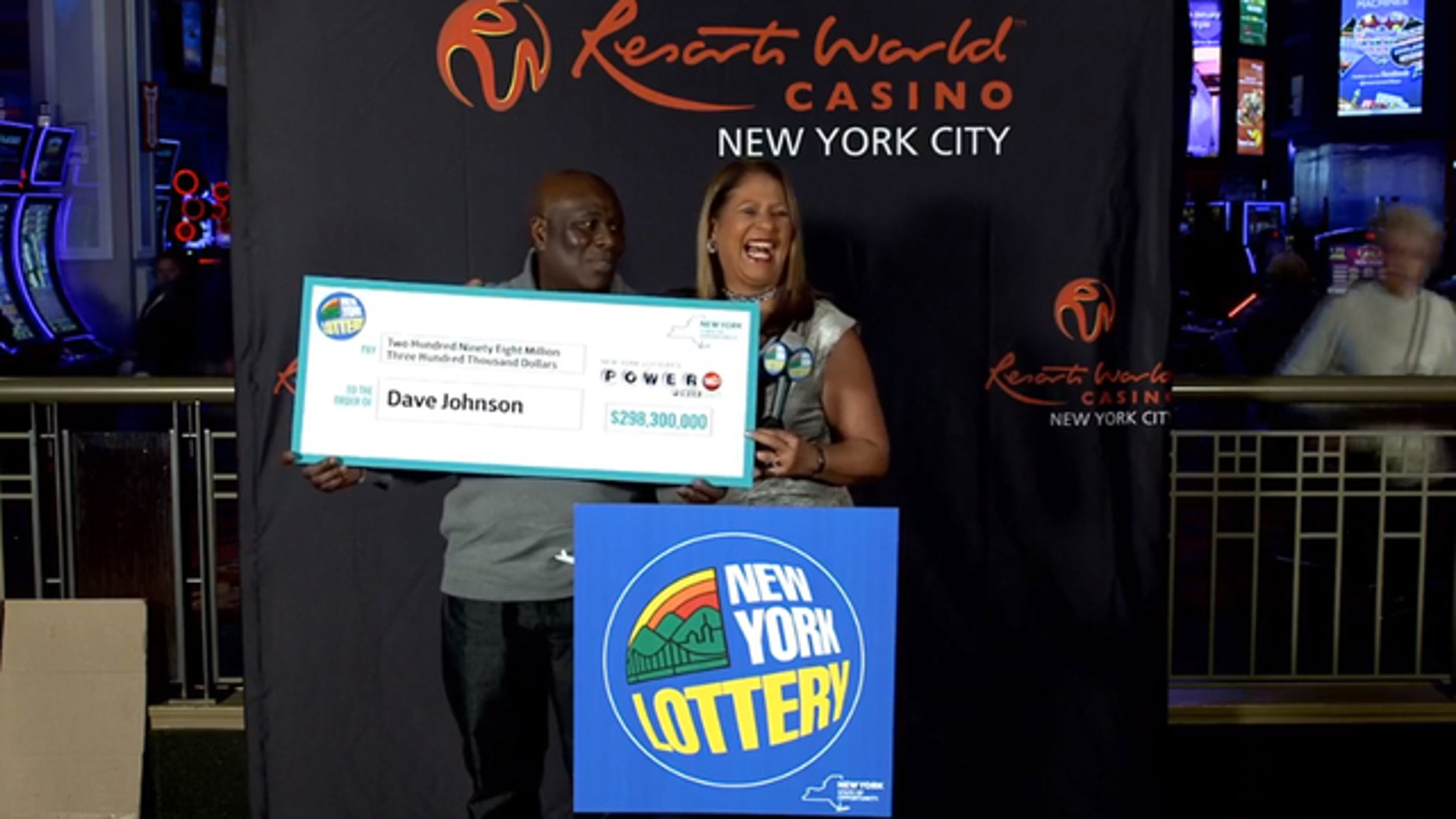 Powerball winner David Johnson collects his prize. (New York Lottery)